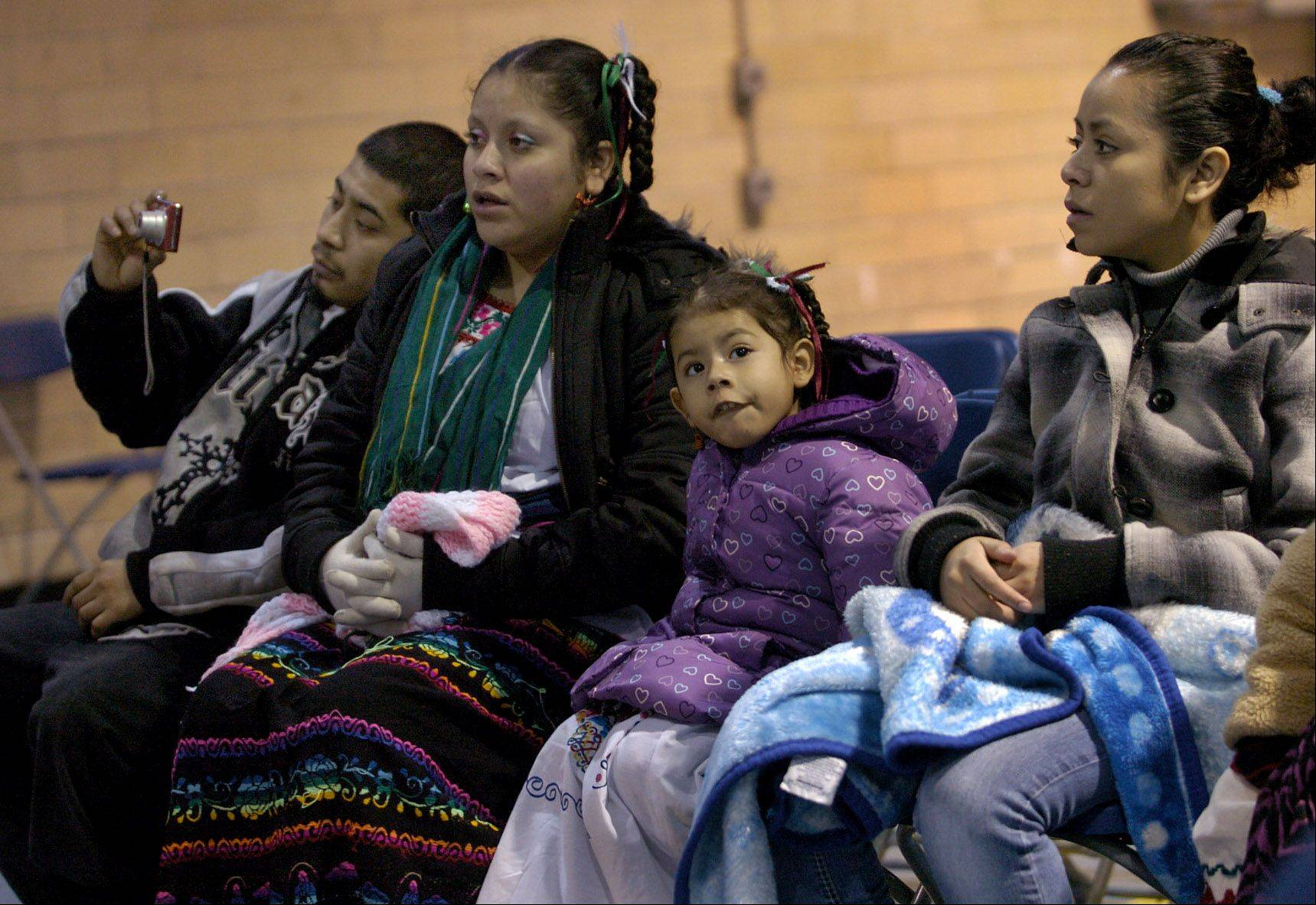 A family attends 9 a.m. Mass at the Shrine of Our Lady of Guadalupe in Des Plaines.