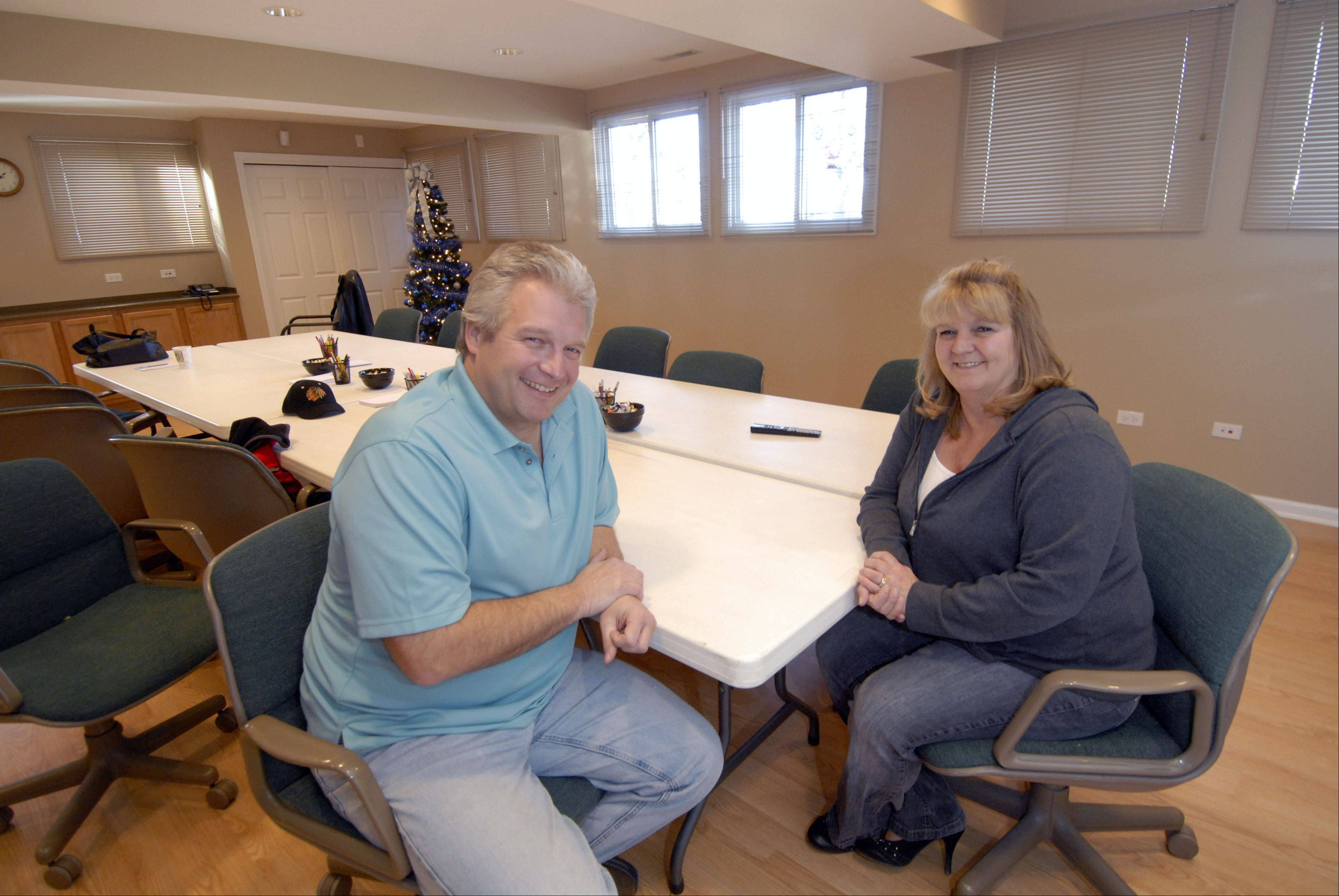 Schaumburg Athletic Association Third Vice President Mike Scharringhausen and President Denise Anderson are at home in the newly renovated old carriage house that had been slated for demolition. The SAA is leasing the building for only $1 a year as its new headquarters.