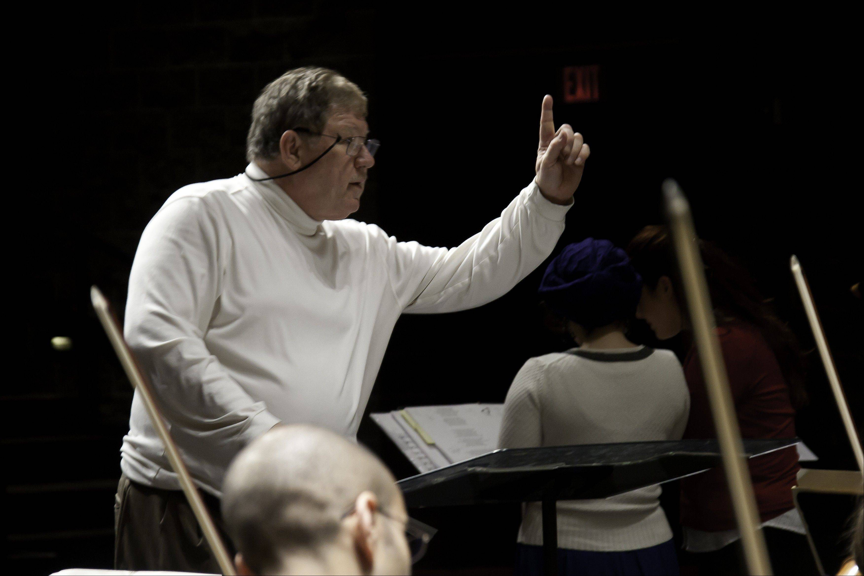 Dr. Verne Schwager conducts the Northwest Festival Orchestra in a rehearsal for the 2010 holiday concert.