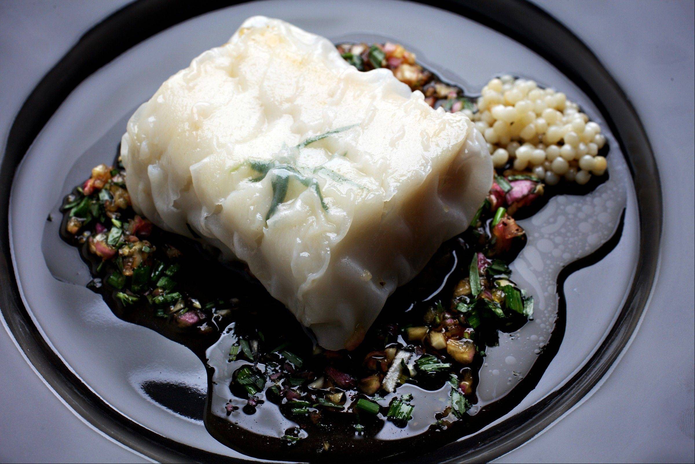 "Haddock in Rice Paper With Shallot and Soy Sauce, from ""Essential Pepin,"" by Jacques Pepin. Illustrates FOOD-PEPIN (category d), by Bonnie S. Benwick (c) 2011, The Washington Post. Moved Monday, Nov. 7, 2011. (MUST CREDIT: Photo for The Washington Post by Deb Lindsey; tableware from Crate and Barrel.)"
