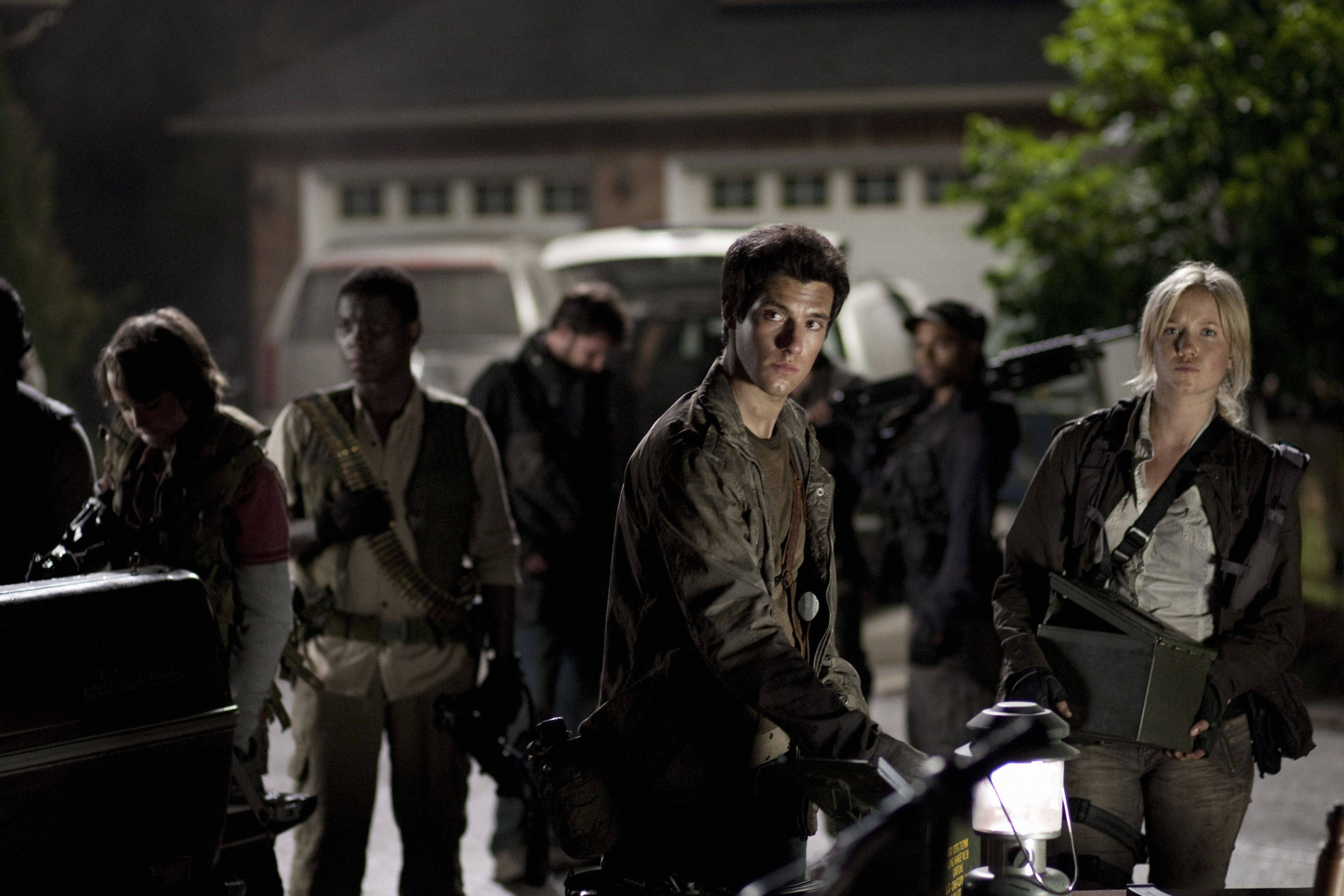 "Buffalo Grove High grad Jessy Schram, right, plays a resistance fighter against alien invaders in the TV series ""Falling Skies."""