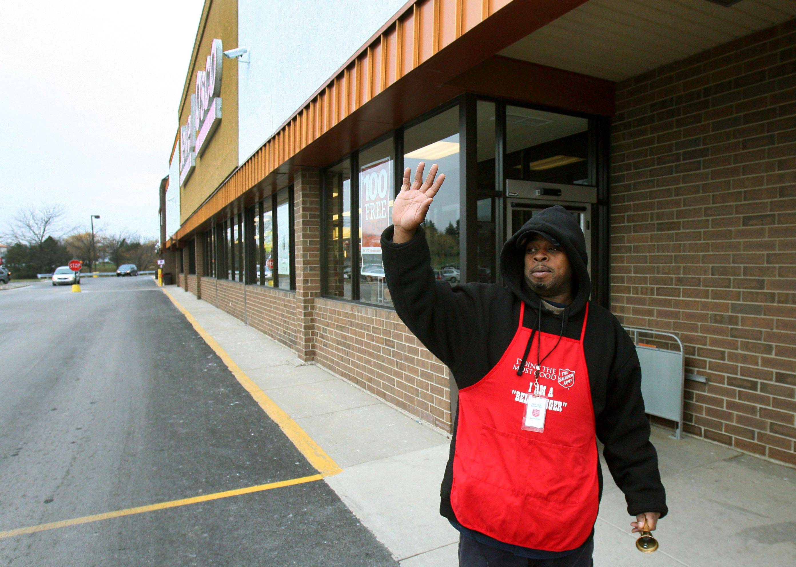 Salvation Army bell ringer Manuel Pate of North Chicago rings his bell in front of Jewel in Libertyville Tuesday.
