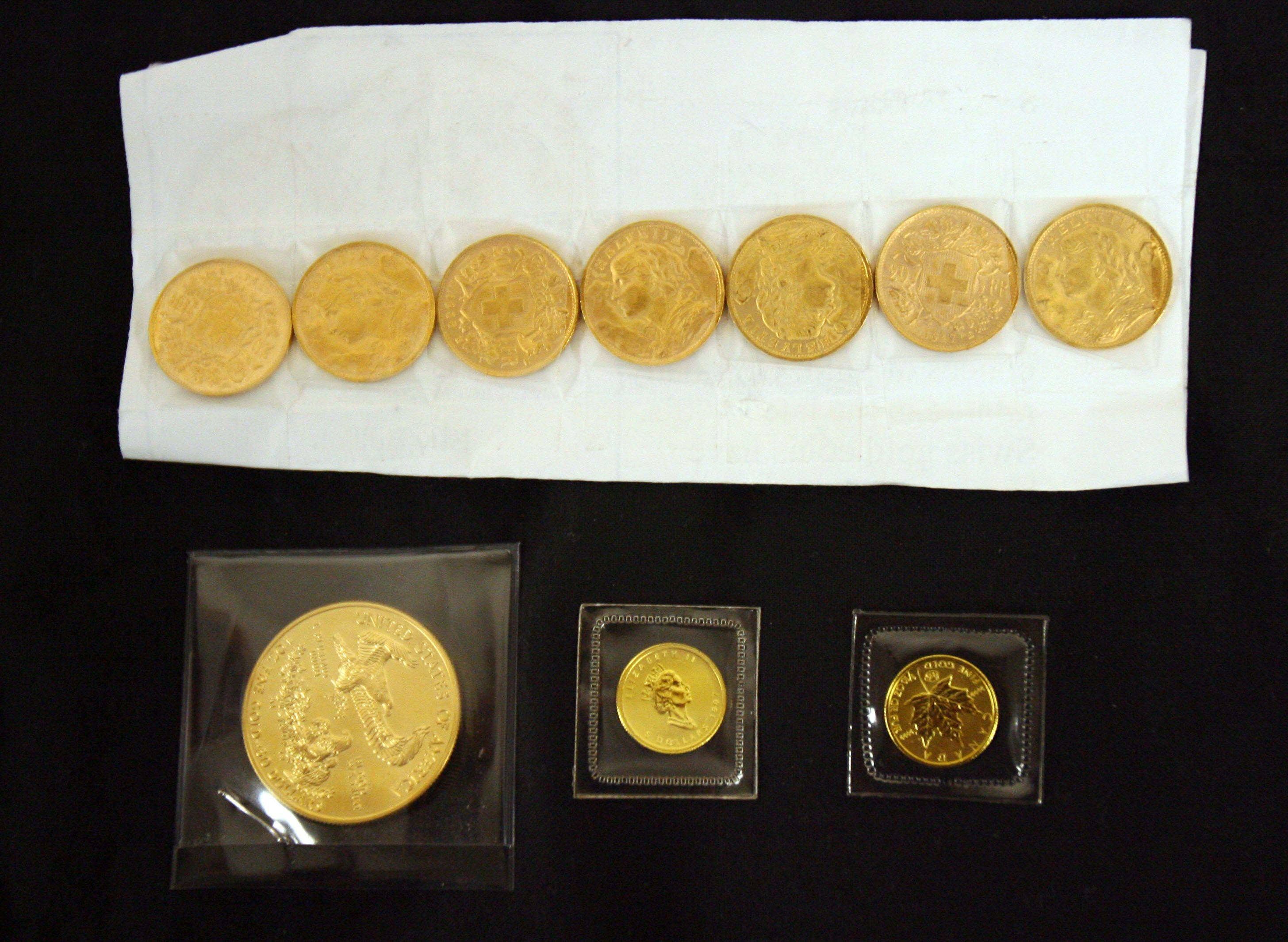 These 10 gold coins were found in three different Salvation Army kettles earlier this month in Lake County. On Monday the anonymous donor of the seven Swiss francs, seen at the top, donated seven more in the same Libertyville kettle.