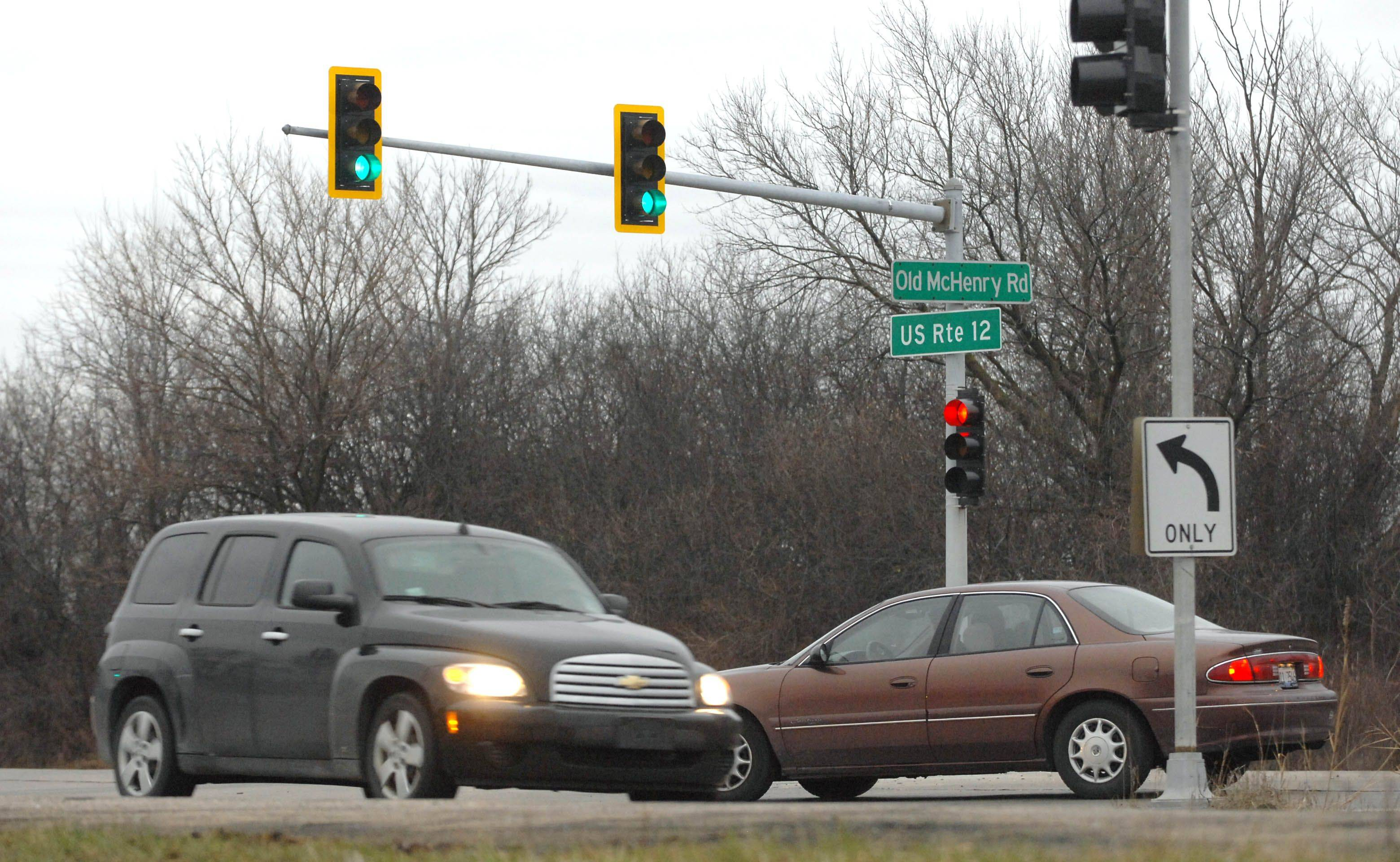 A vehicle waits to make a left-hand turn onto Old McHenry Road from southbound Route 12, right, Tuesday morning. A 10-year-old child died from injuries suffered in a car crash at that intersection Monday evening.