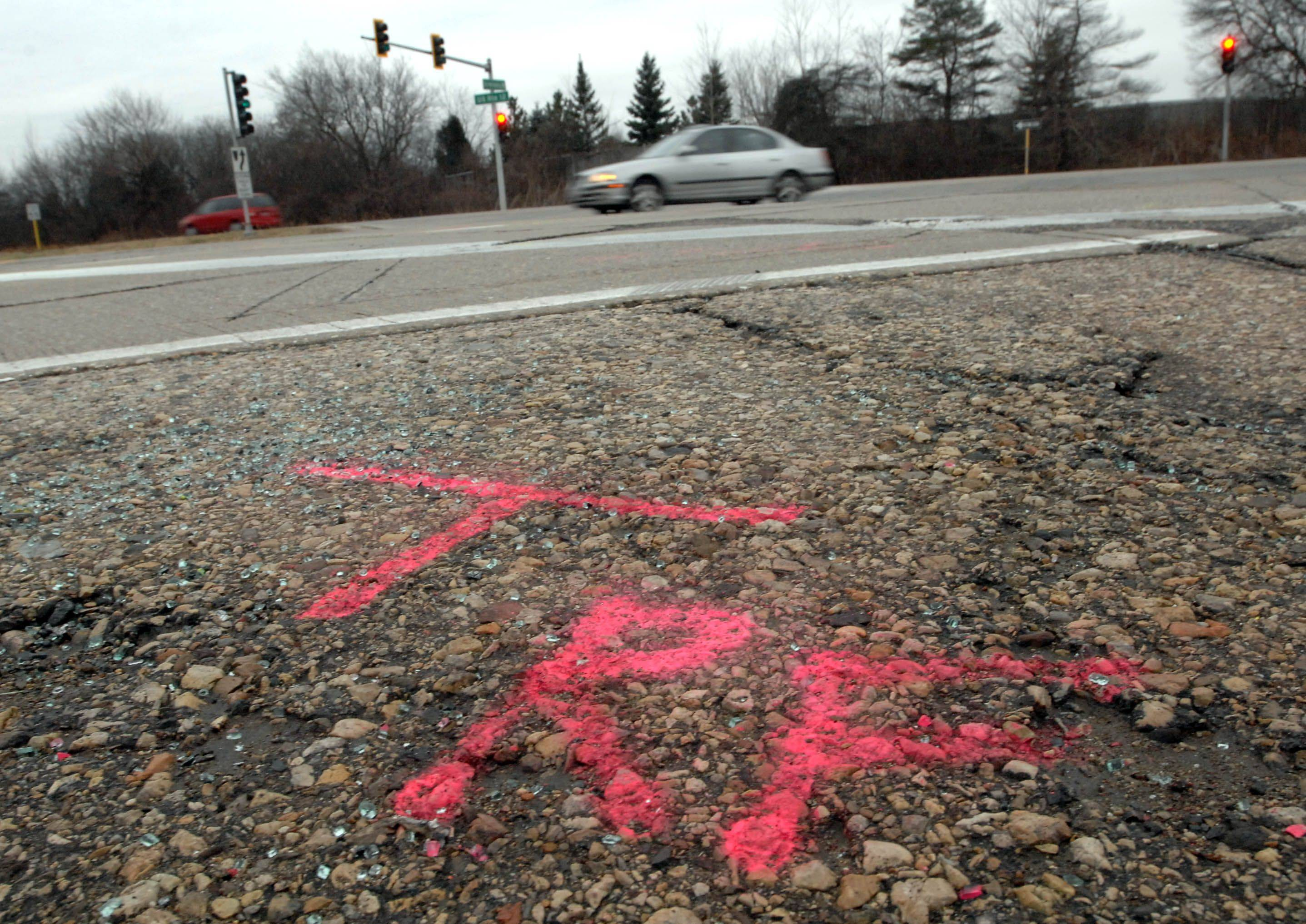 Police investigation markings at the intersection of Route 12 and Old McHenry Road near Lake Zurich where a 10-year-old child was killed Monday evening.