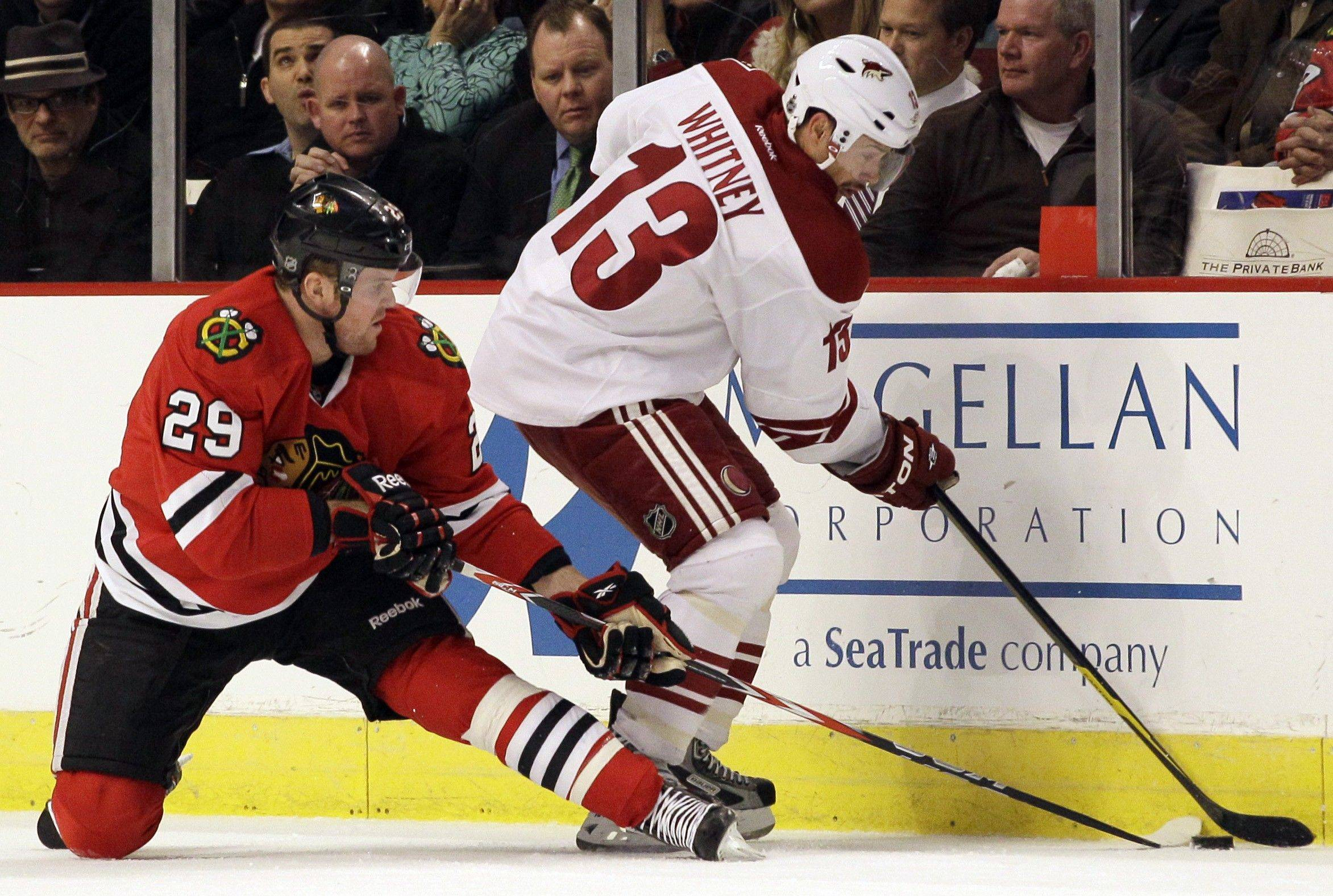 Phoenix Coyotes' Ray Whitney and Bryan Bickell of the Blackhawks battle for the puck in a game last month. Bickell is a minus-8 with only 3 goals this season.