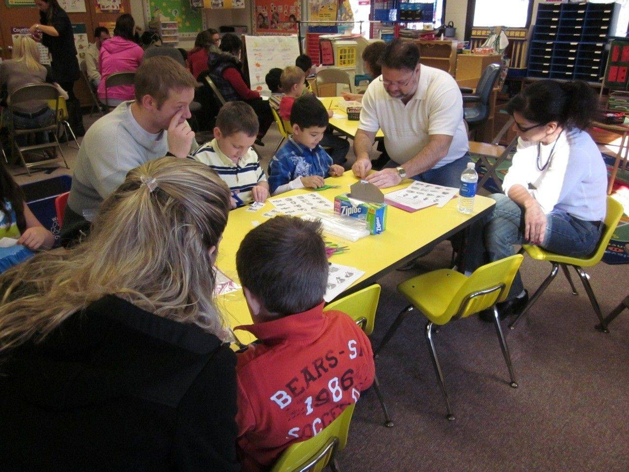 Plainfield parents joined their children at a Kindergarten Family Literacy Night hosted by Plainfield Elementary School. Pictured, from left, facing camera: James Kurtz, Aidan Kurtz, Daniel Owens and Jerome and Maria Owens.