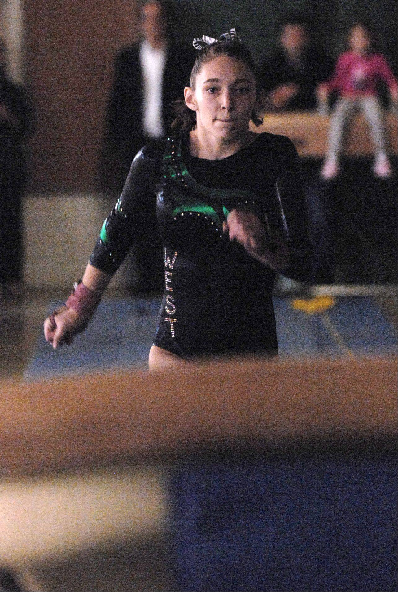 Nicole Pagor of Glenbard West performs on the vault during a dual gymnastics meet against Lyons Township in at home in Glen Ellyn.