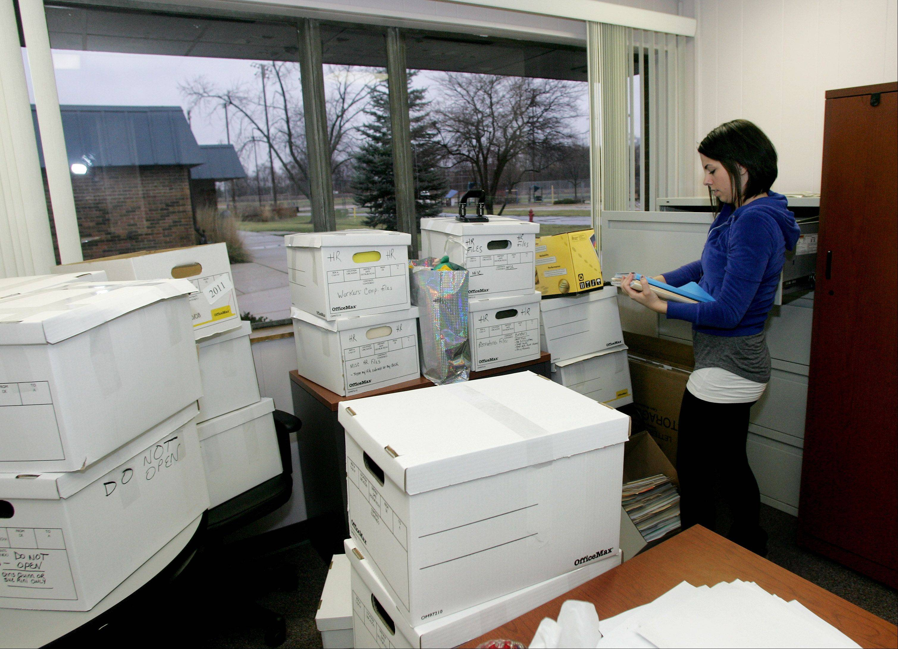 Nicole Parisi of the Carol Stream Park District packs materials in the human resources department at the Aldrin Community Center, which is scheduled for demolition in the next few months.