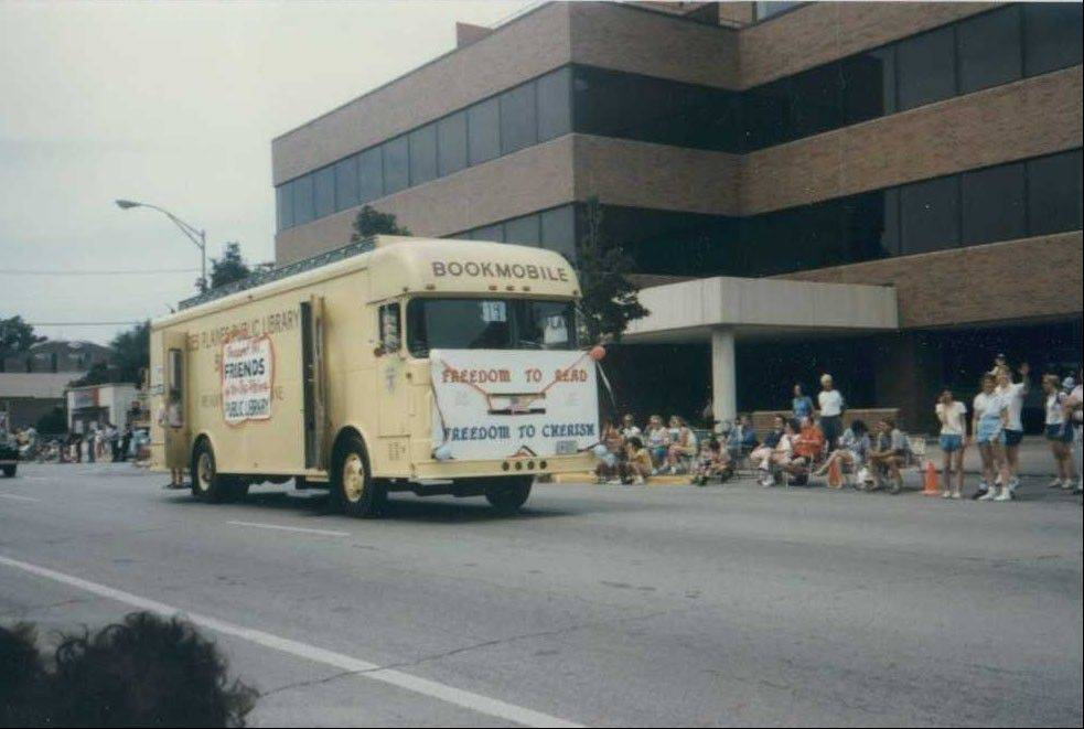Des Plaines Public Library's bookmobile service, started in June 1969, will cease Saturday. The yellow bookmobile seen here was the library's second. The mobile library was a regular feature in Des Plaines' Fourth of July parade.