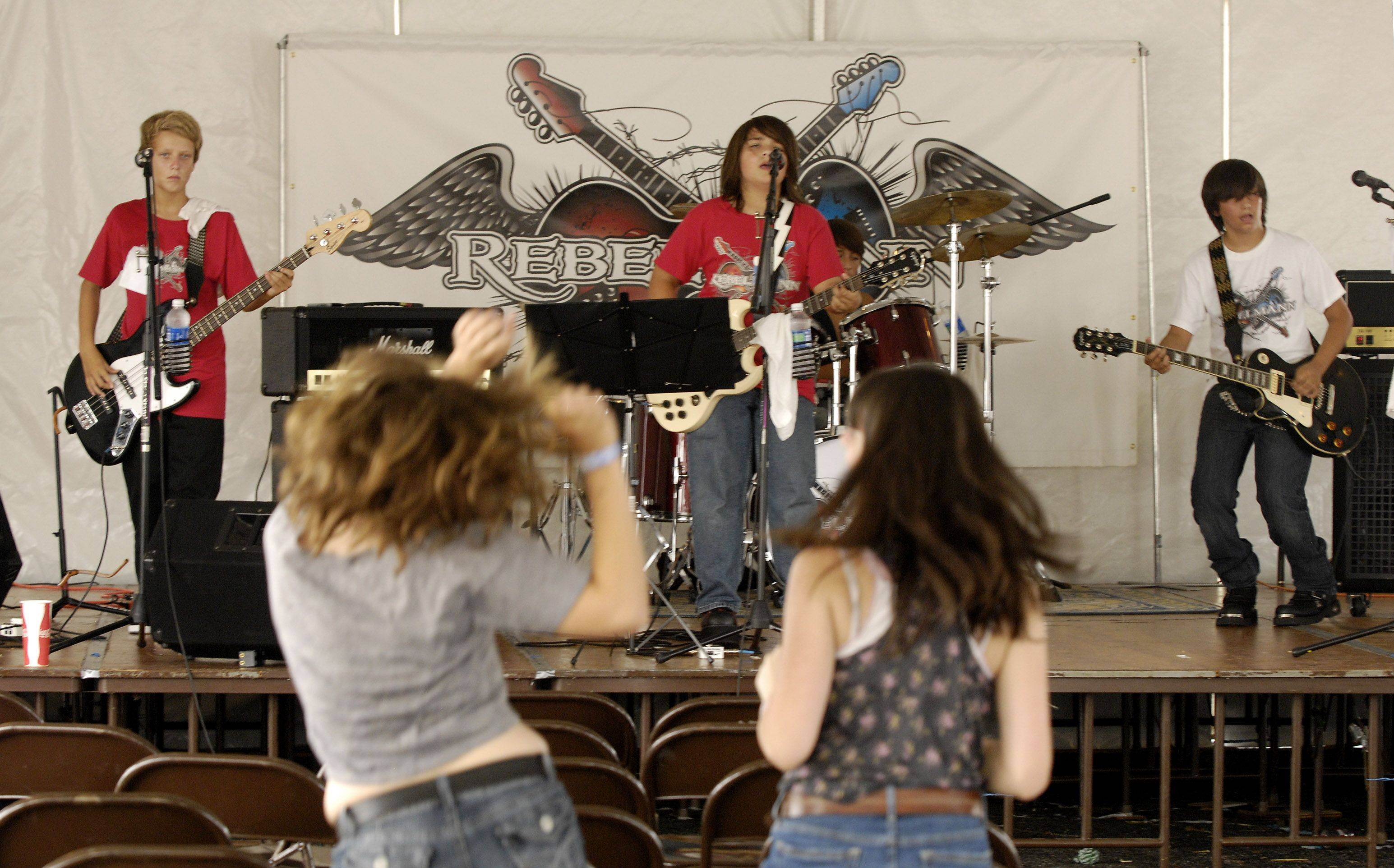 Rebelmann performs at the 2011 DuPage County Fair in Wheaton. Bassist Grant Mason, left, has since left the band.