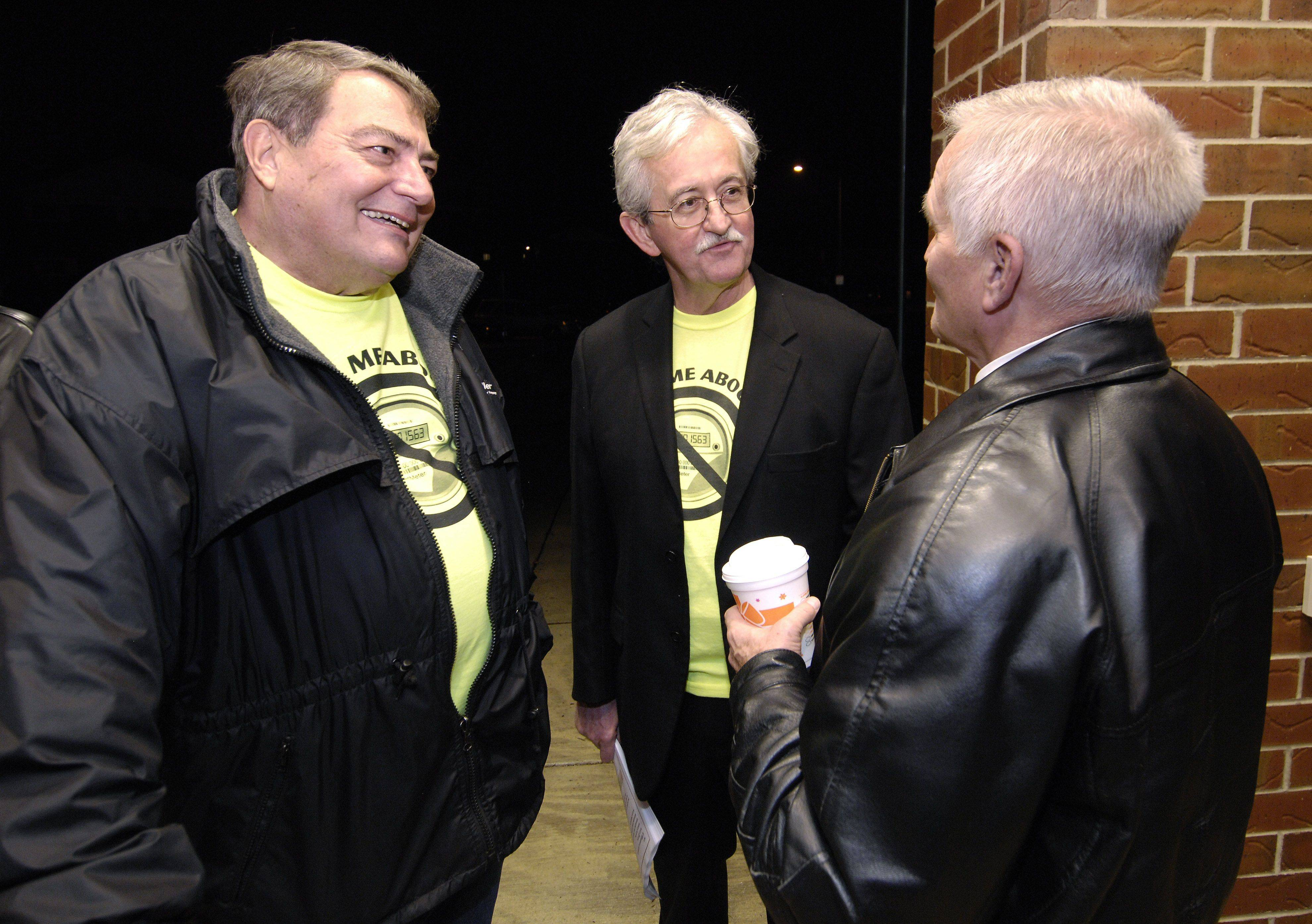 Smart Grid opponents Jerry Schilling and John Glass speak with Dick Furstenau outside the open house at Washington Junior High, where Naperville residents could learn more about the Naperville Smart Grid Initiative (NSGI).