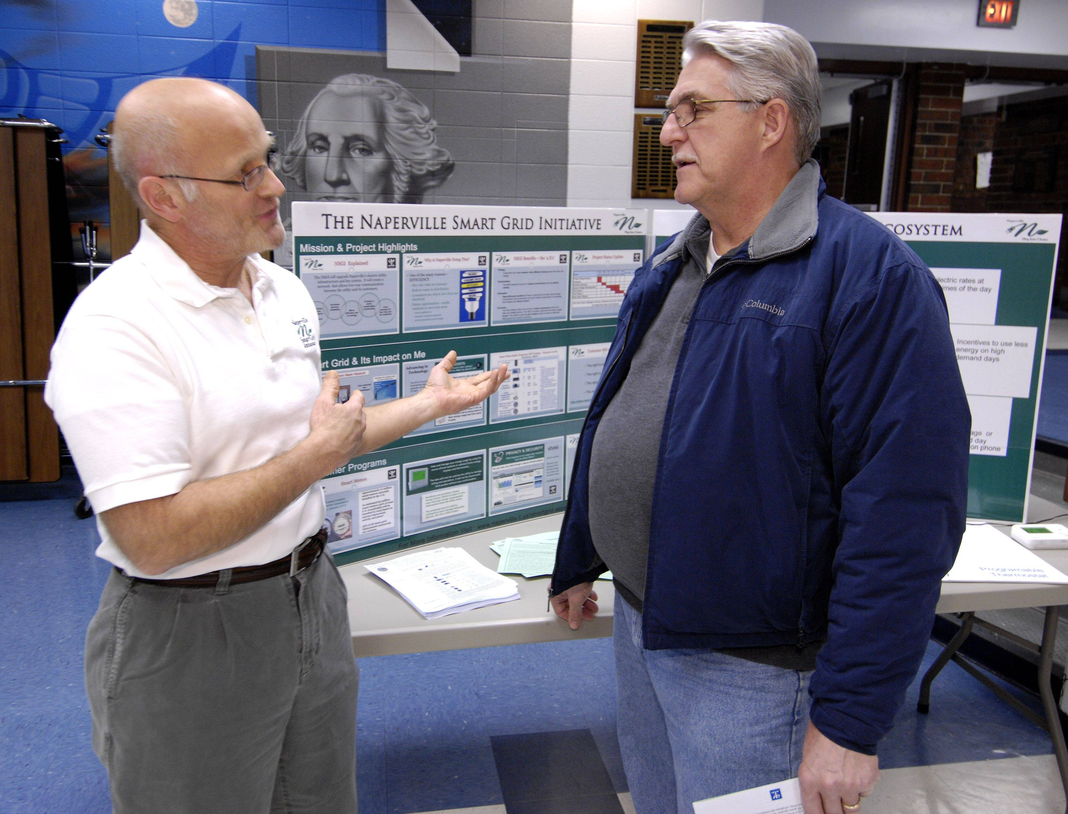 Smart Grid Ambassador Al Glodowski speaks with Naperville resident Tim Ory Wednesday during an open house at Washington Junior High, where Naperville residents could learn more about the Naperville Smart Grid Initiative (NSGI).