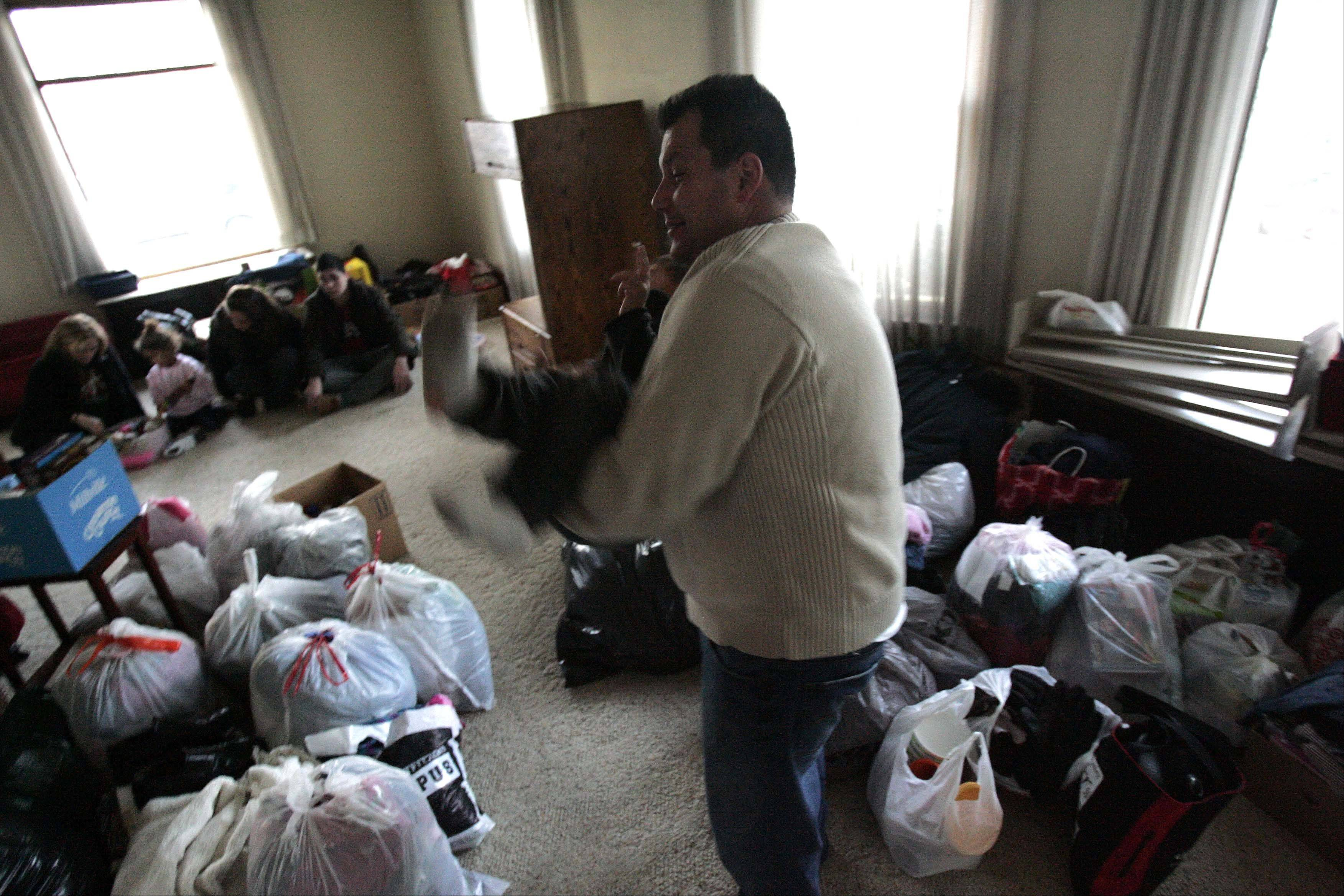 """This is like a toy farm,"" remarked Keaton Fisher, 5, as his dad Jack plays with him in the front room of their donated home. ""I got here this afternoon and I realized that all I had was eight garbage bags full of clothes, and that was my whole life,"" he said."