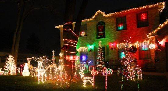 a wonderful array of lights and decorations help illuminate the ragos house at 404 w