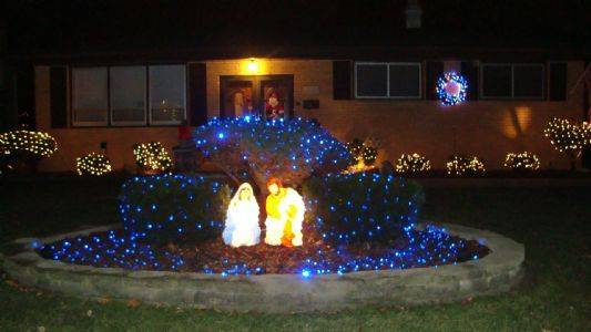 Blue lights highlight Mary, Joseph and Jesus in the nativity scene at the Durante home at 613 N. Willow in Itasca.