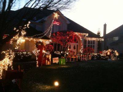 The Wincek home at 1408 Justin Court in Naperville features Santa surrounded by reindeer and presents. A musical light show and the star of David round out the display.