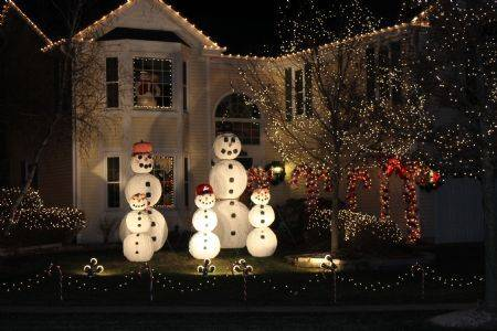 The Frosty Family at 530 Farmhill Circle in Wauconda has a 13-foot father, a 10-foot mother and 5-foot children. The snowmen are all one of a kind and represent someone in the Jakubek family.