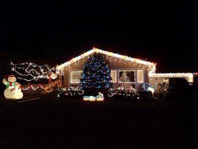Kyle Domzalski says his house at 914 Sumac Lane in Mount Prospect is where Santa comes to enjoy beautiful Christmas lights and raise the roof.