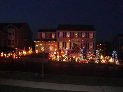 The Hurleys have 52 blow molds, 32 Christmas trees, 18 animated displays, 12 d and 12,000 lights (6,300 are programmed to music) at their home at 582 Wexford Drive in Elgin. Brian says his father always told him they decorated their house so Santa could find it. He says, when his son was born, he really wanted to make sure Santa found them. The display also includes a parkway filled with trees and deer. The snow-family in the middle represents the Hurleys. You can also see Santa flying behind the angles on the left of the driveway lead by Rudolf. The laser show runs for 20 minutes on the garage.