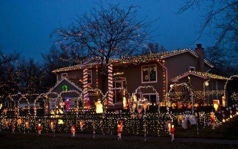 One picture can't capture all that is on display at the Koehler house at 529 Hingham Lane in Schaumburg, says Brian Koehler. The side yard includes several more yard decorations, including 20 foot snowman and 15-foot hot air balloon carrying Santa. In total, the house as 10,000 lights.