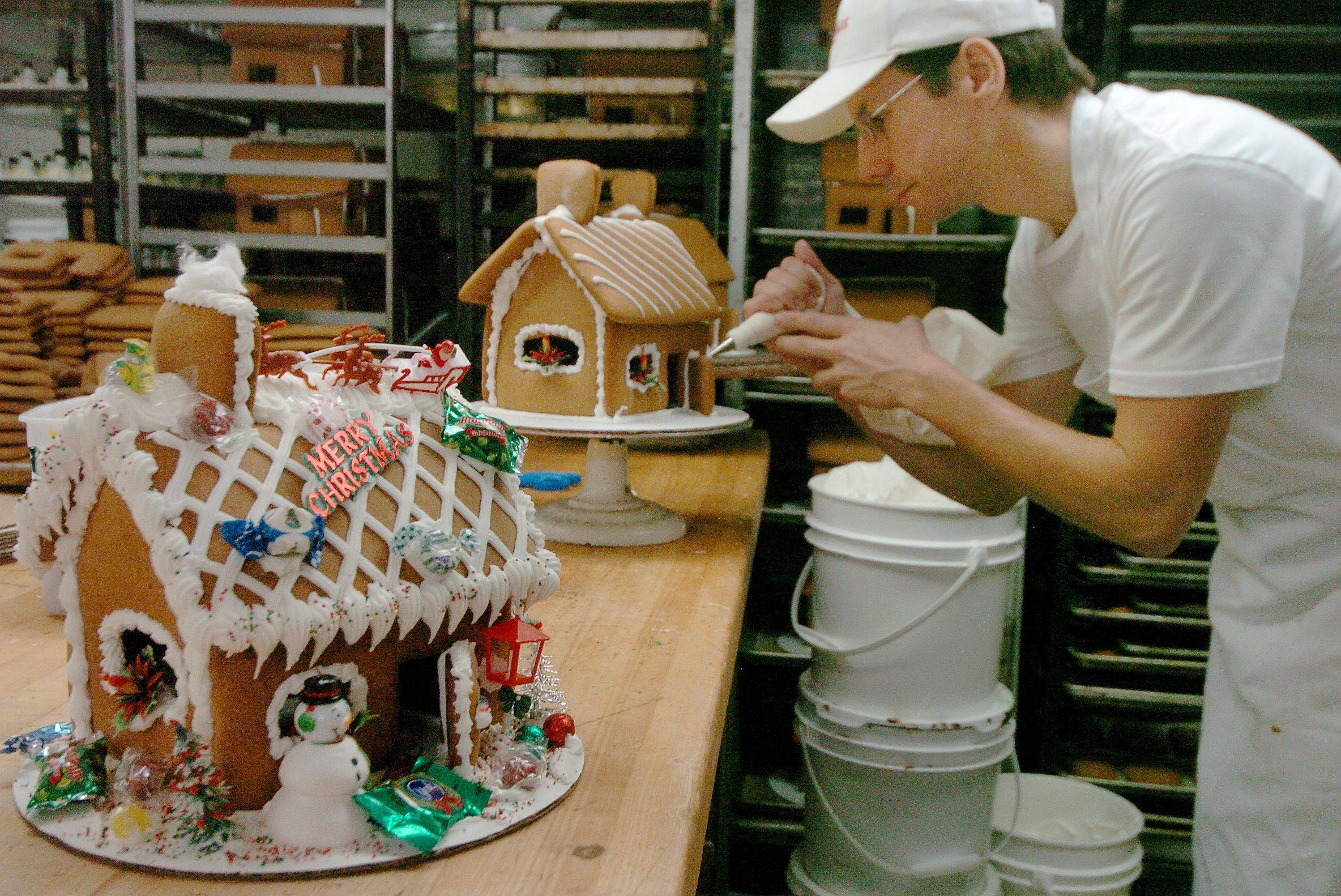 Kowalczyk puts the finishing touches on one of 200 gingerbread houses.