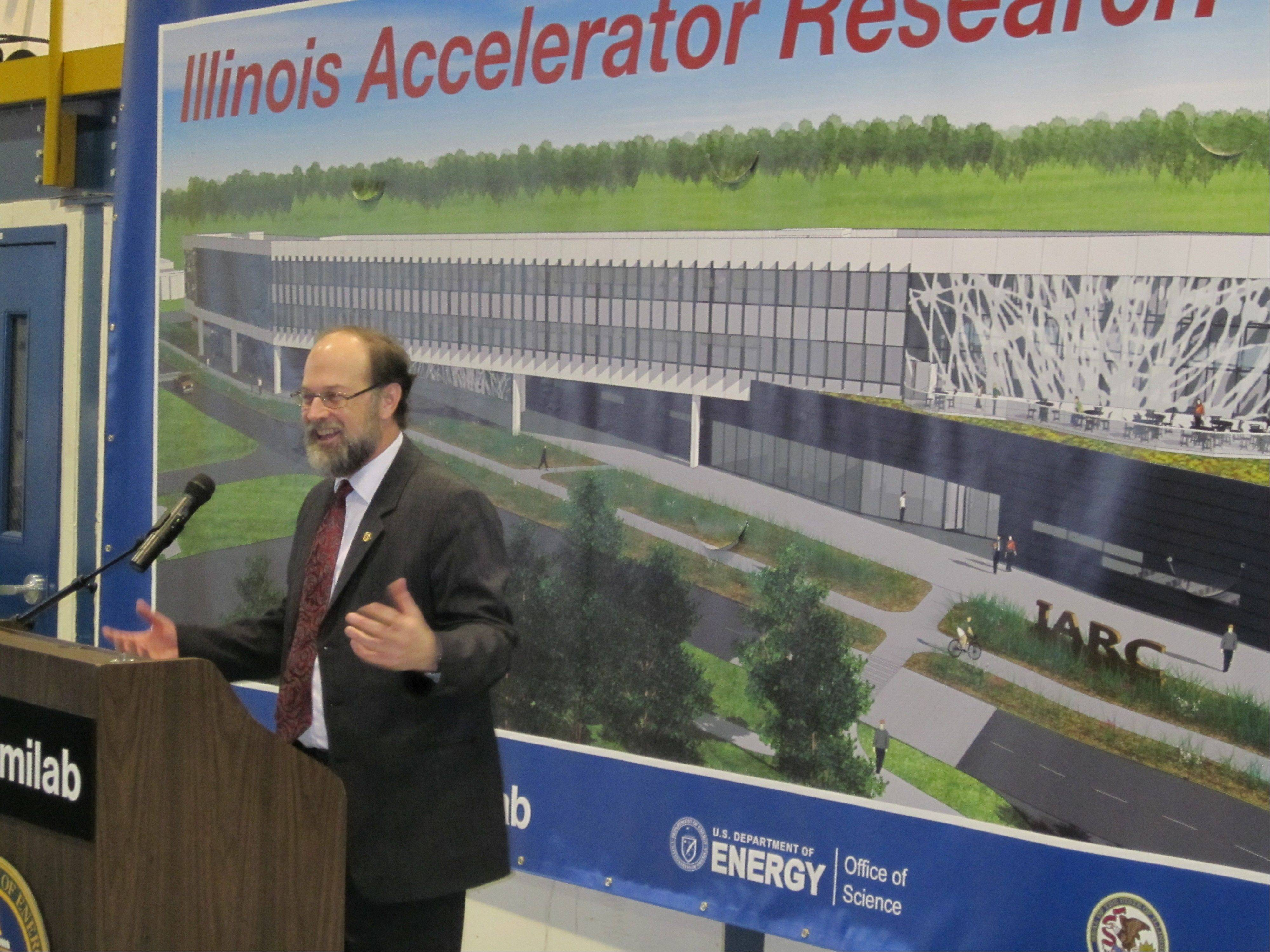 State Rep. Mike Fortner of West Chicago, a particle physicist, Friday explains how the new Illinois Accelerator Research Center will help industry and commerce in Illinois, at a groundbreaking ceremony for the center at Fermilab.