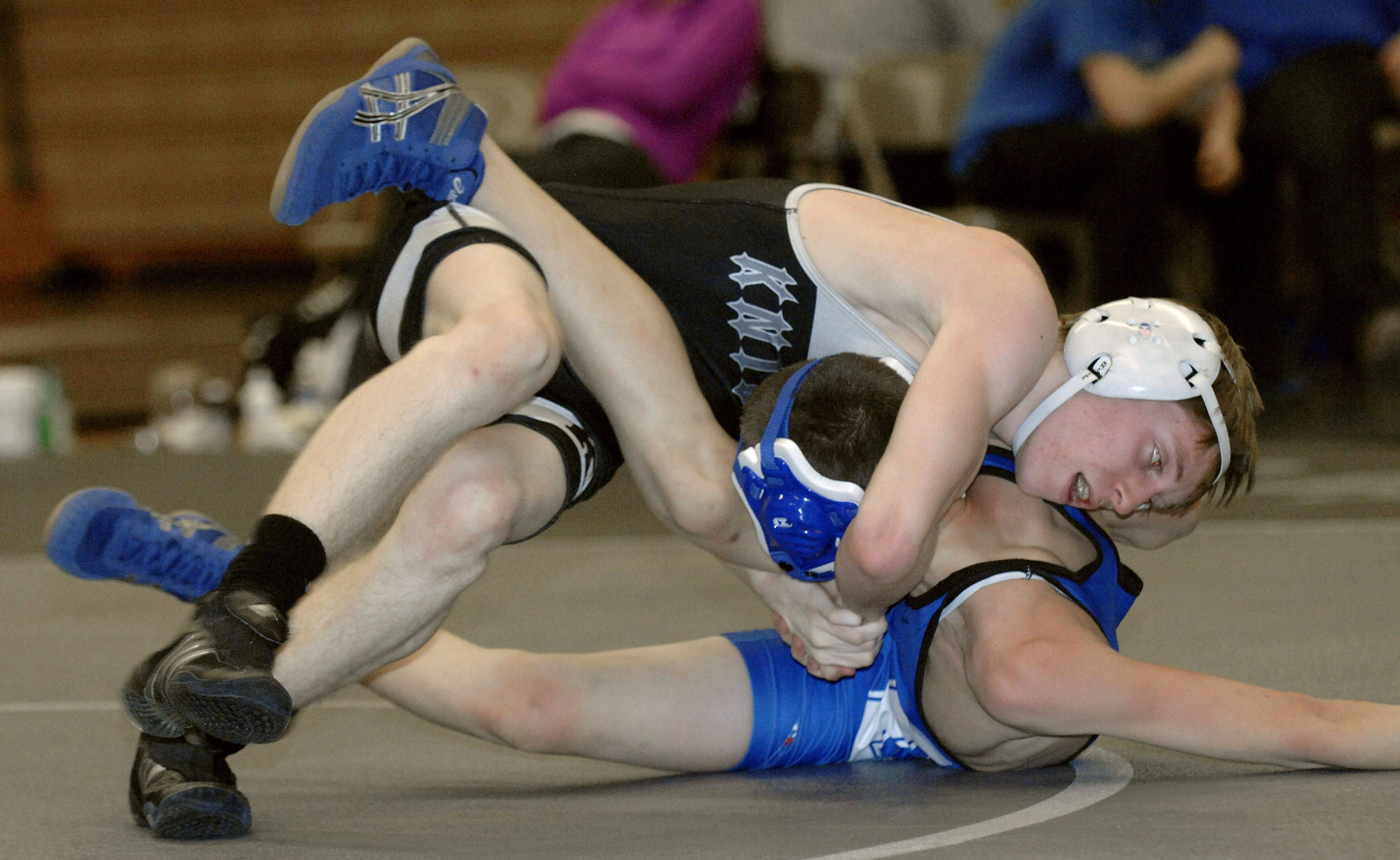 Kaneland's Steve Gust and Geneva's Chris Davis in the 106 match on Saturday, December 17. Davis turn the match around to take the win.