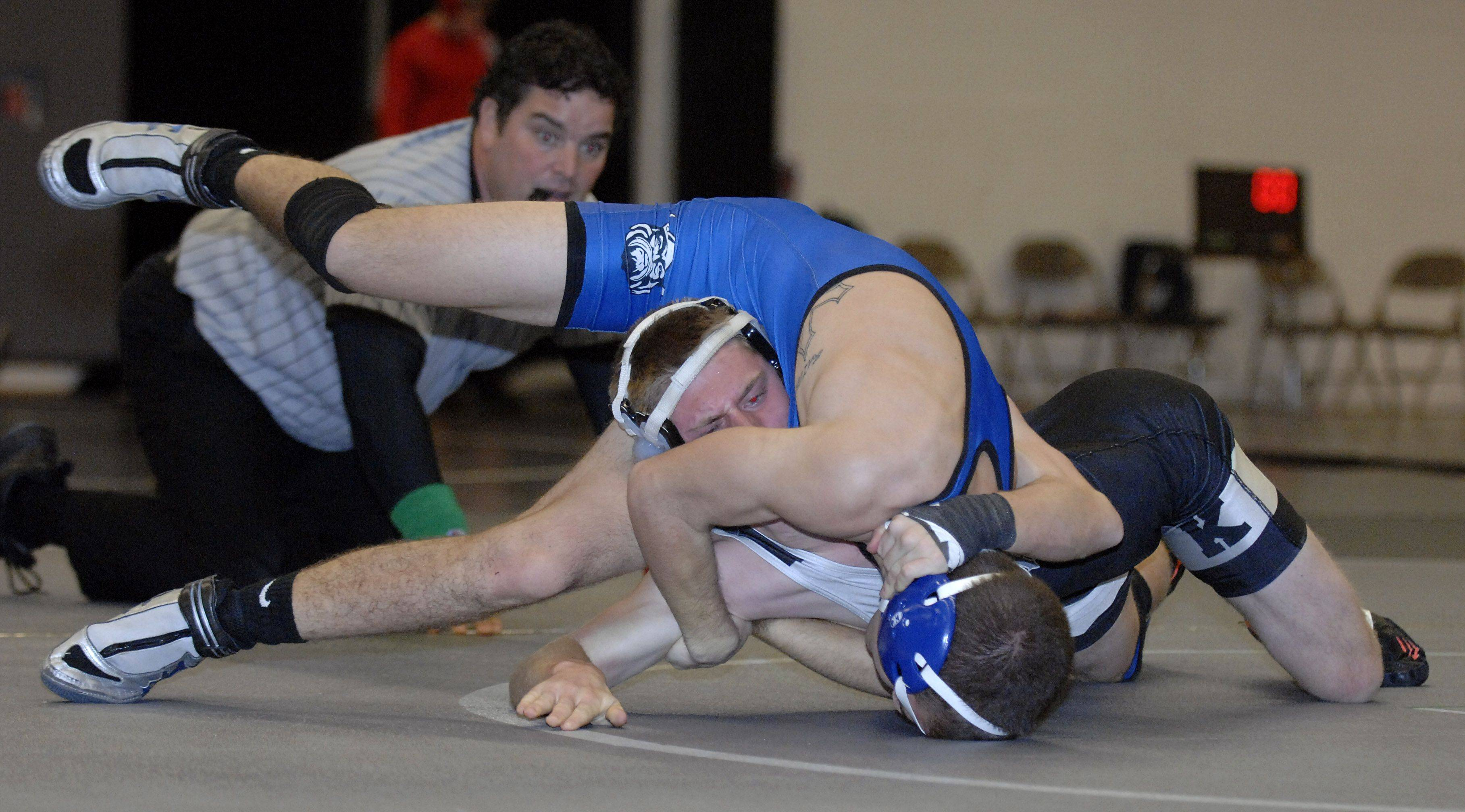 Geneva's Brad Martens takes the 120 match over Kaneland's Luke Kreiter on Saturday, December 17.