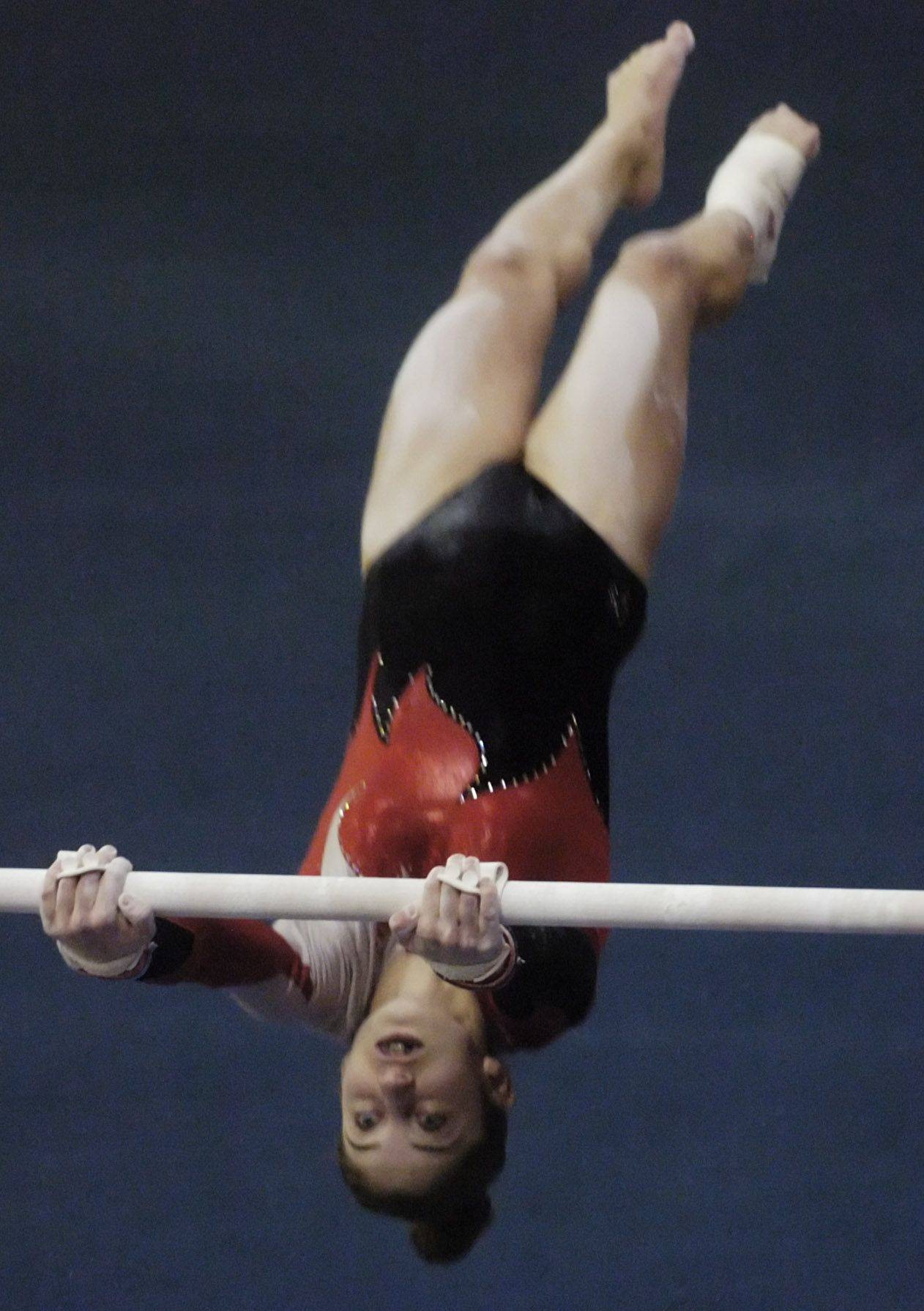 Palatine's Claudia Przystal competes on the uneven parallel bars during Saturday's Palatine gymanstics invitational.