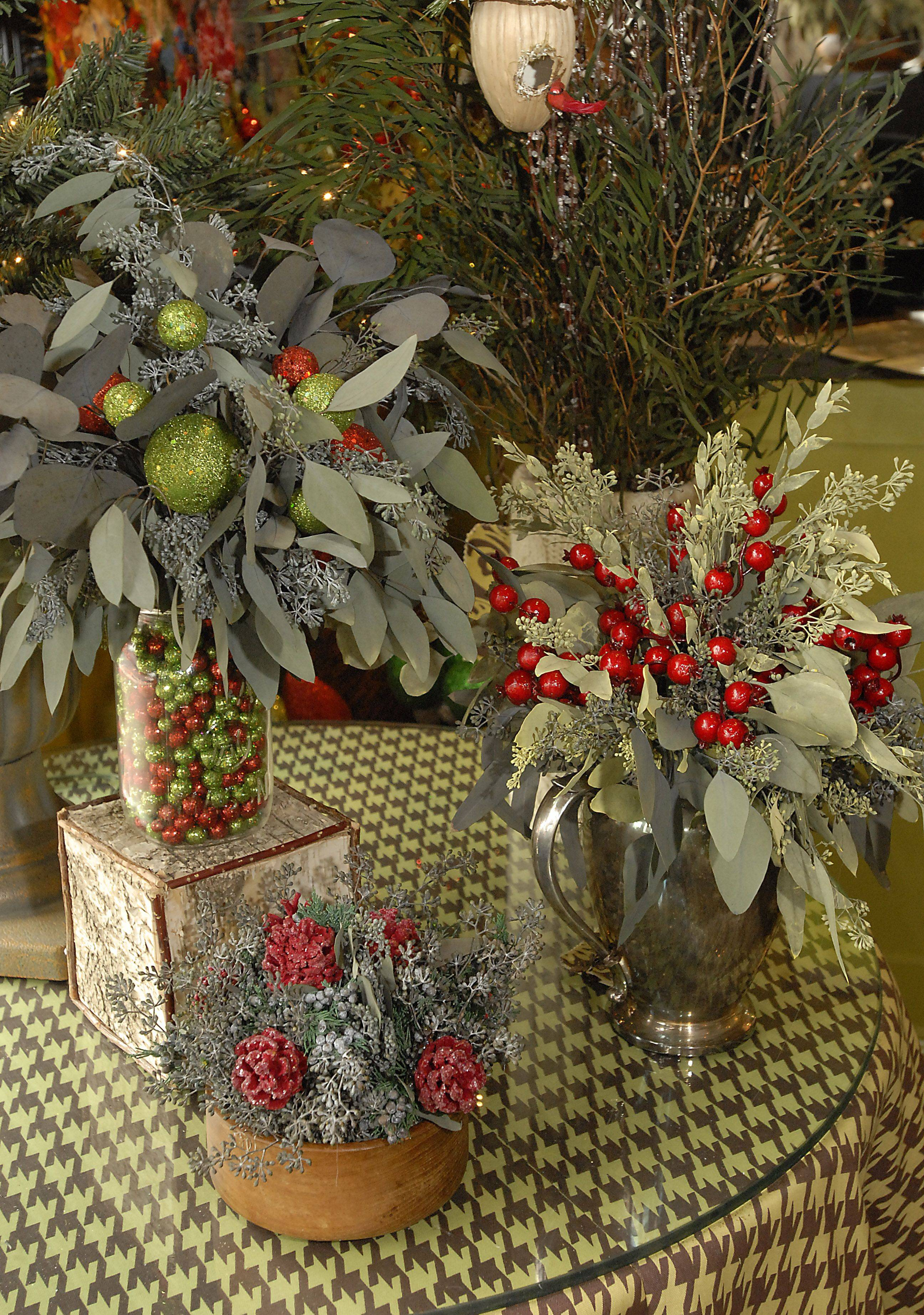All kinds of thrift shop items turn into elegant vases for Gail Kueker's preserved greenery.
