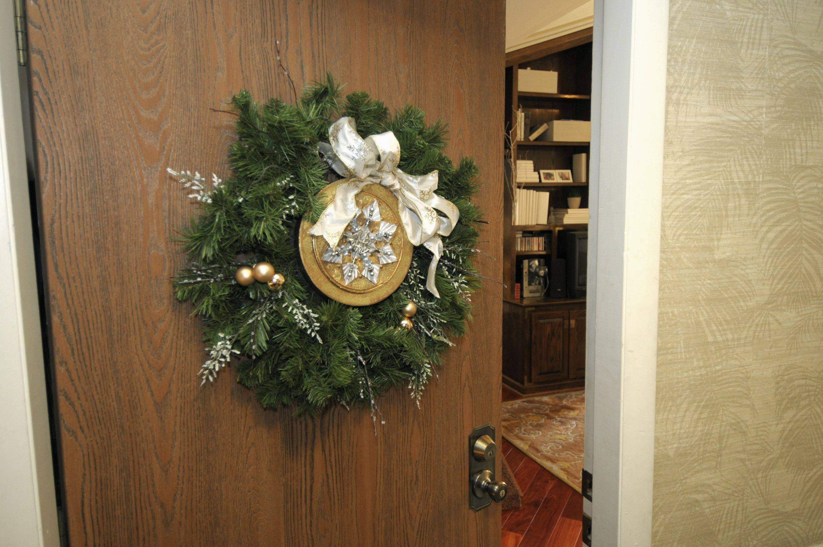 Janet Davidsen used a round cardboard box as the center of this decoration for her door in Wheaton.