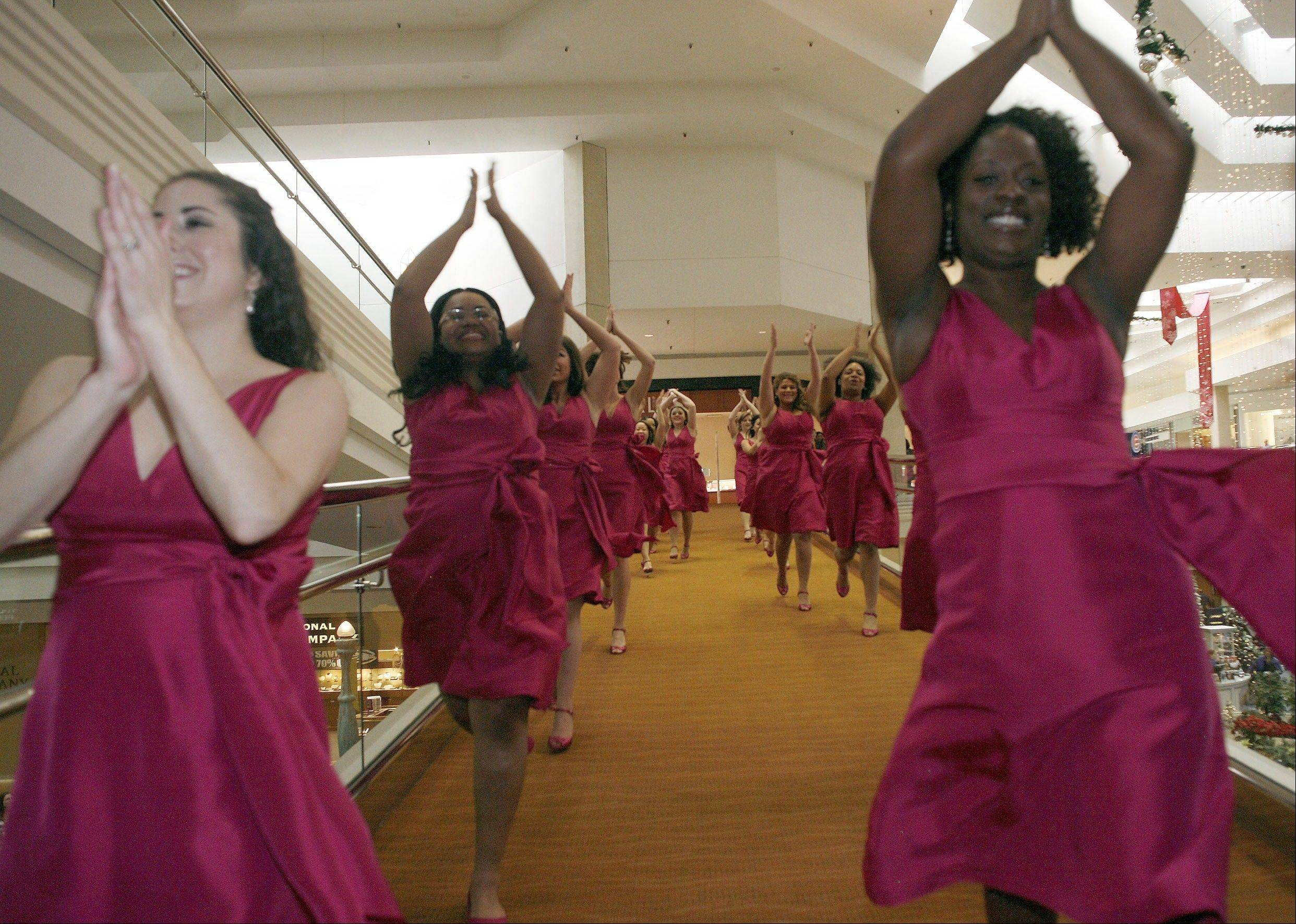 "More than 100 dancing women converged on Woodfield Mall earlier this month for a ""surprise musical performance"" that later became a national T-Mobile ad called ""Home for the Holidays."" The commercial has aired on national television and has nearly 2.5 million YouTube views. Most of the dancers were local women, and some were from Schaumburg and Barrington high schools."