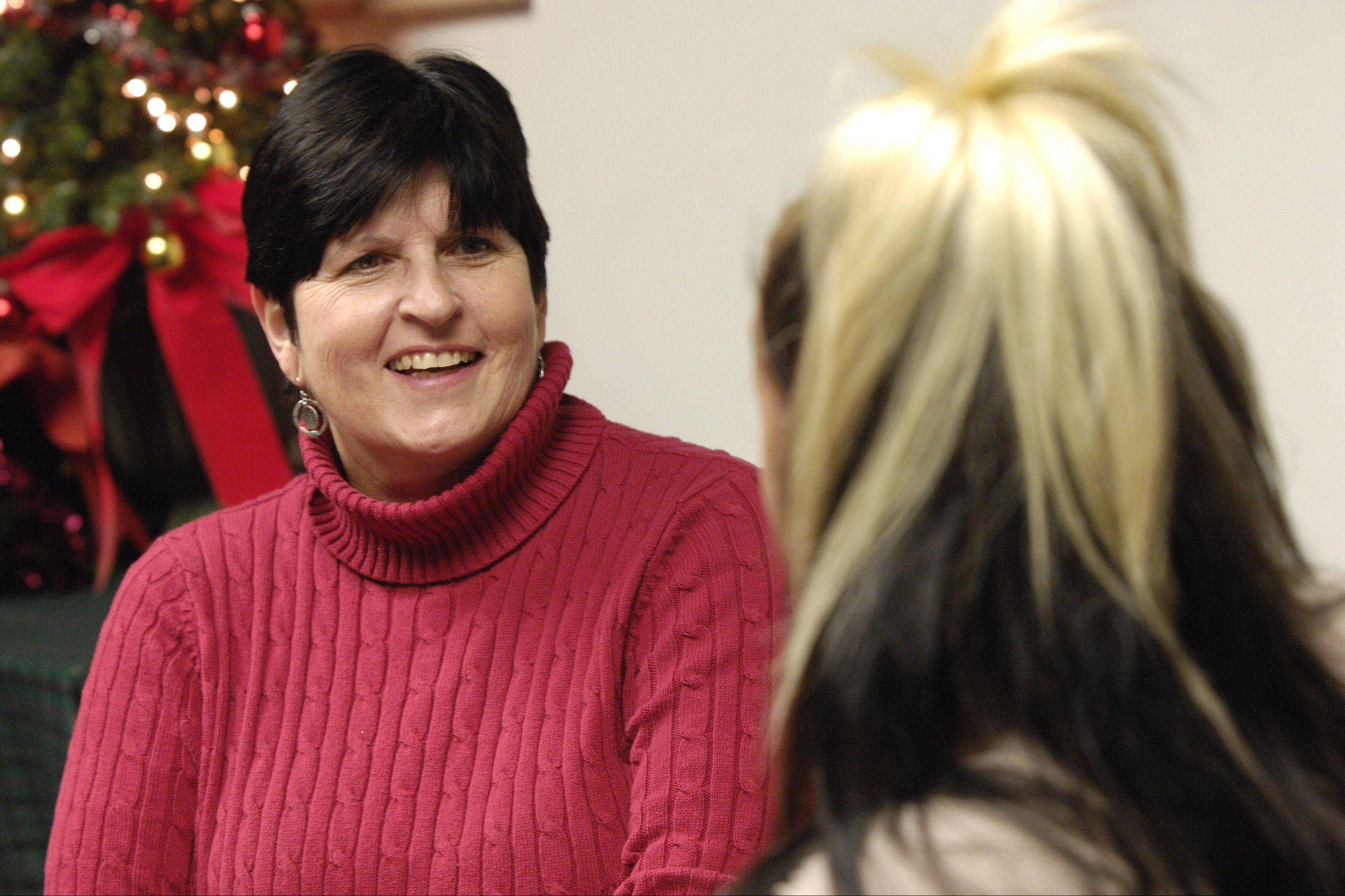 Serenity House counselor and Recovery Home Program Manager Donna Foyle talks with a resident and recovering heroin addict at the Addison facility. Serenity House helps people restart their lives after battling drug addiction.