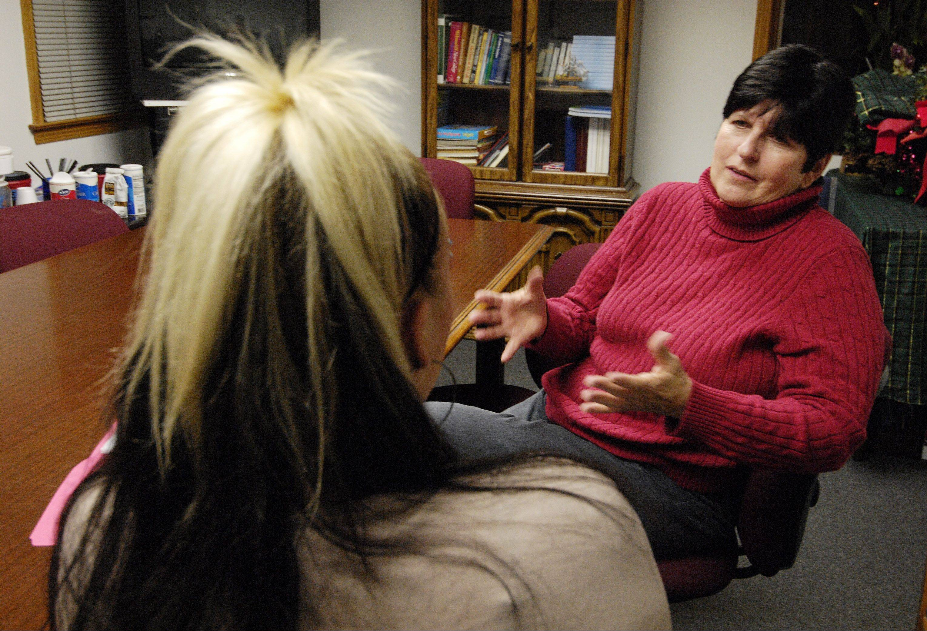 Serenity House counselor and Recovery Home Program Manager Donna Foyle talks with a resident and recovering heroin addict at the Addison facility. Serenity House helps people restart their lives after drug addiction.