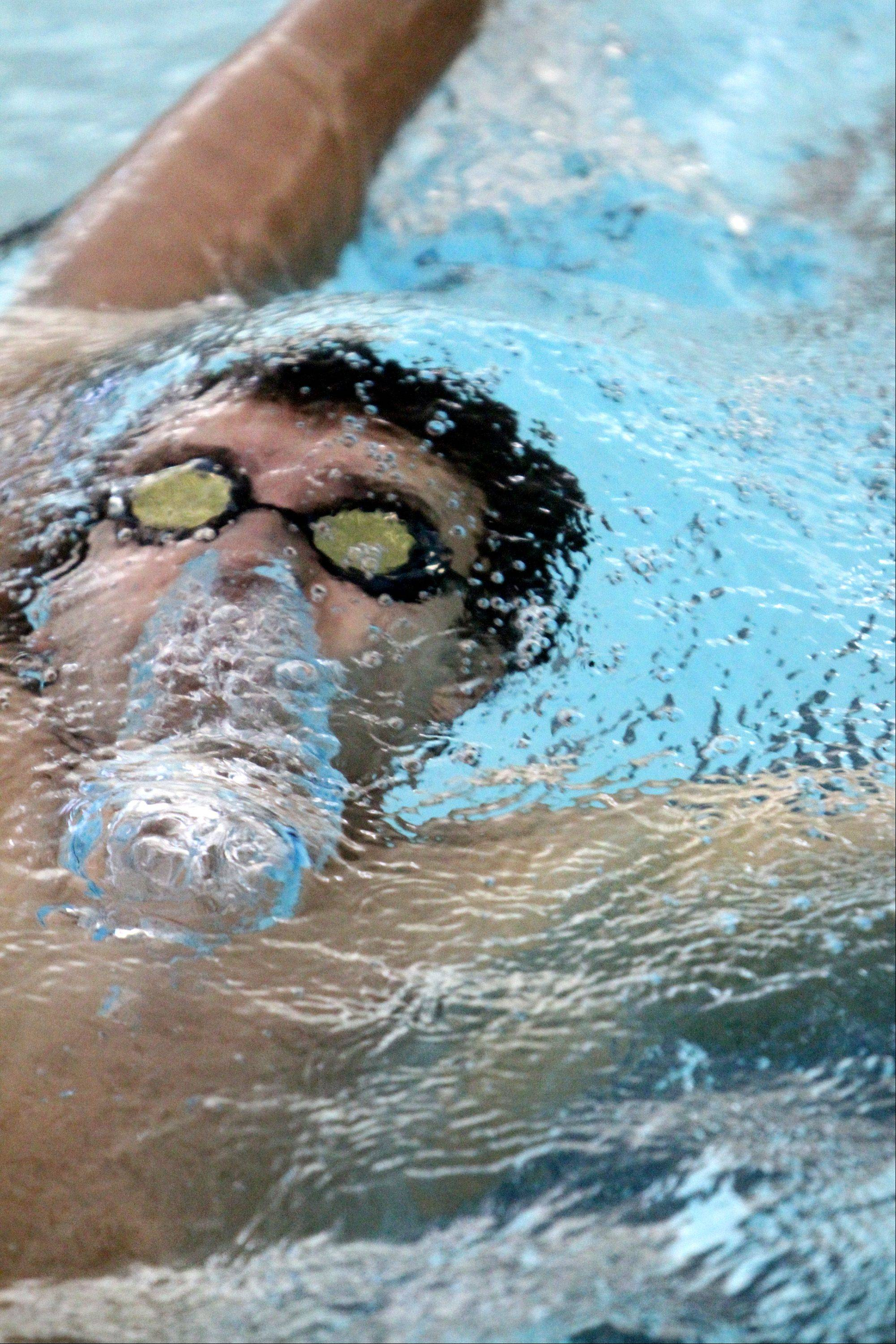 Mundelein's Jason Rehor swims the second heat of the 200-yard individual medley at Stevenson High School Saturday in Lincolnshire.