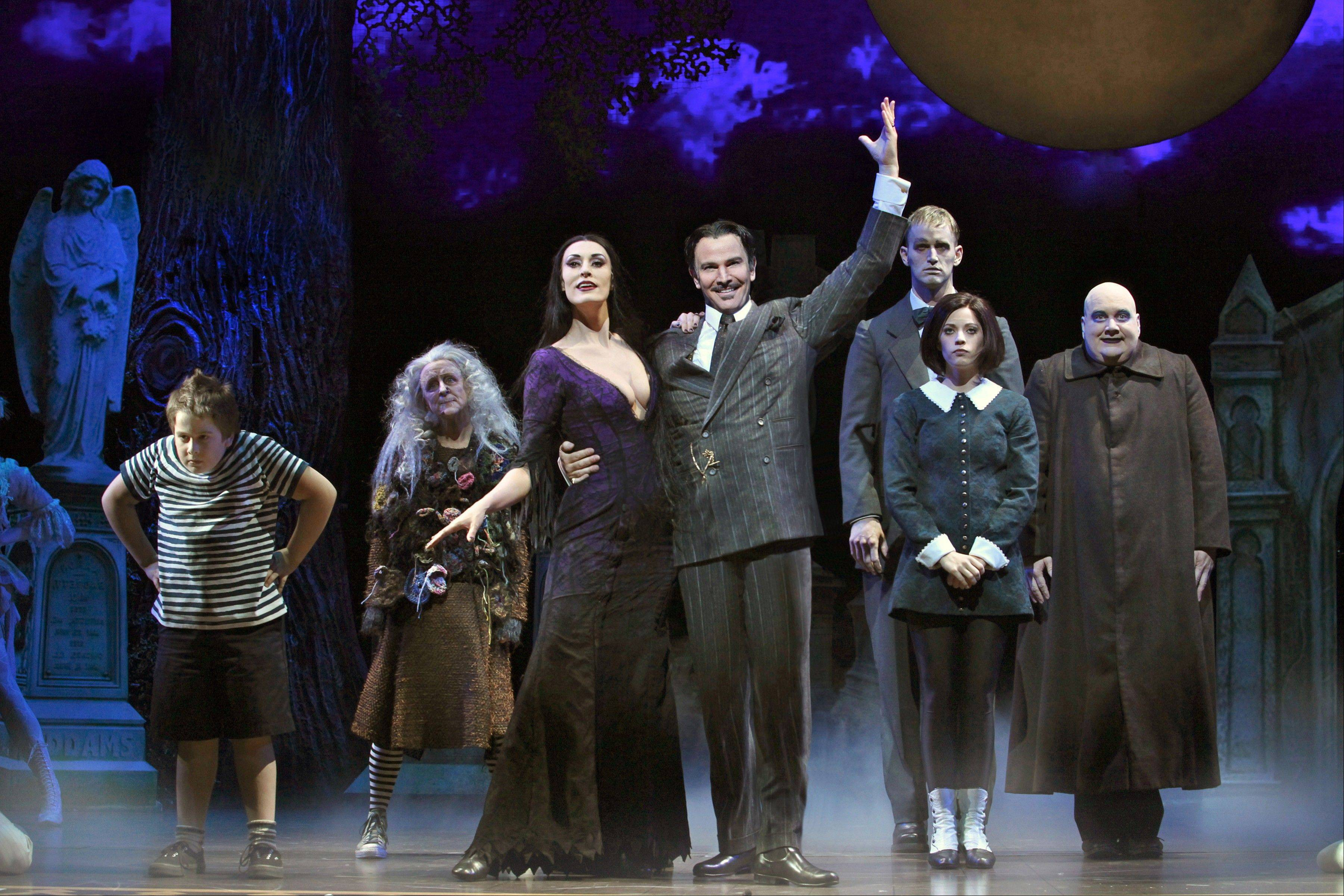 """The Addams Family,"" starring Pugsley (Patrick D. Kennedy), left, Grandma (Pippa Pearthree), Morticia (Sara Gettelfinger), Gomez (Douglas Sills), Lurch (Tom Corbeil), Wednesday (Cortney Wolfson) and Uncle Fester (Blake Hammond), say hello in a revamped national tour that comes to Chicago's Cadillac Palace Theatre next week."