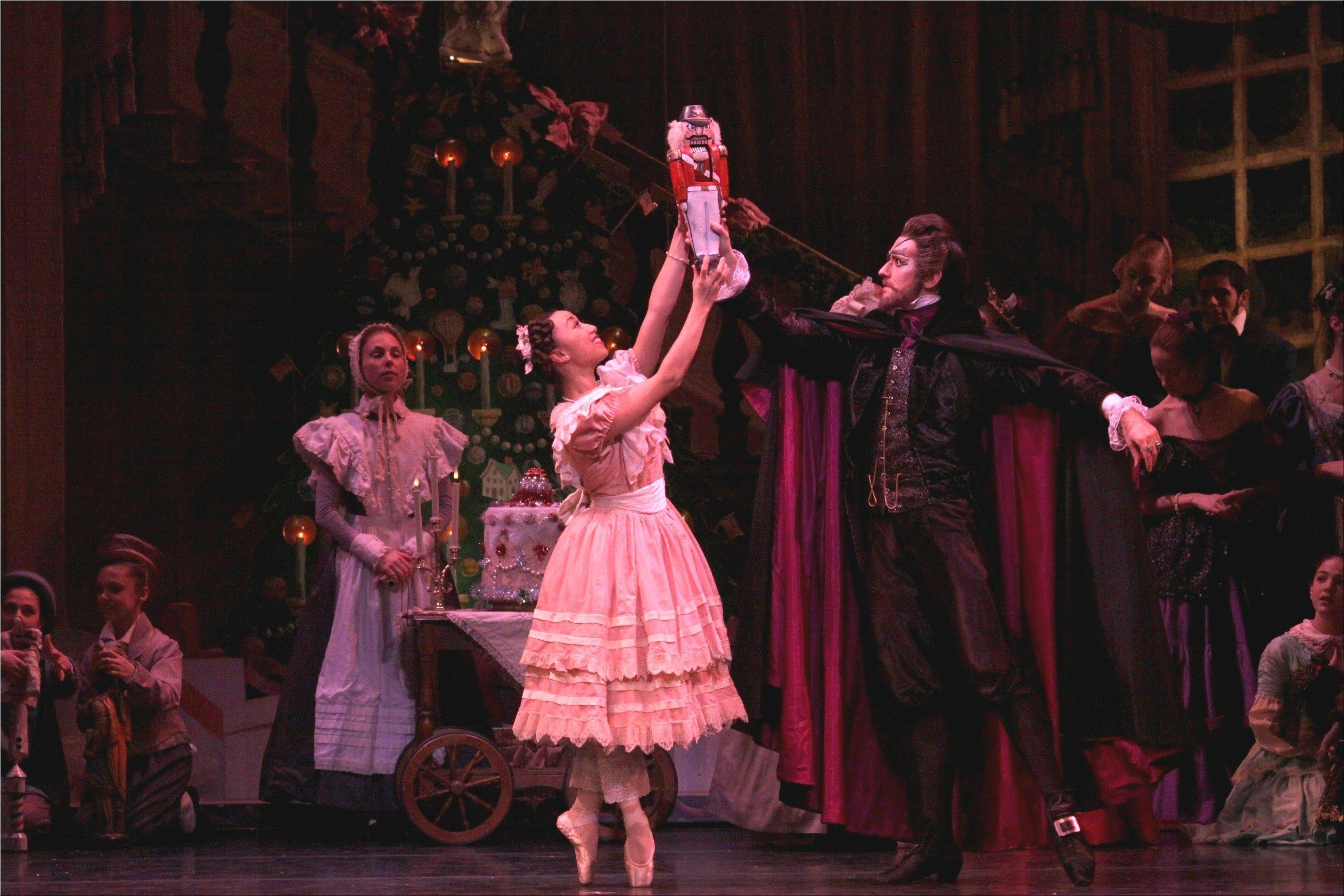 "Clara (Anastacia Holden) is given a Nutcracker by Dr. Drosselmeyer (Matthew Adamczyk) in the Joffrey Ballet's ""The Nutcracker"" at the Auditorium Theatre of Roosevelt University in Chicago."
