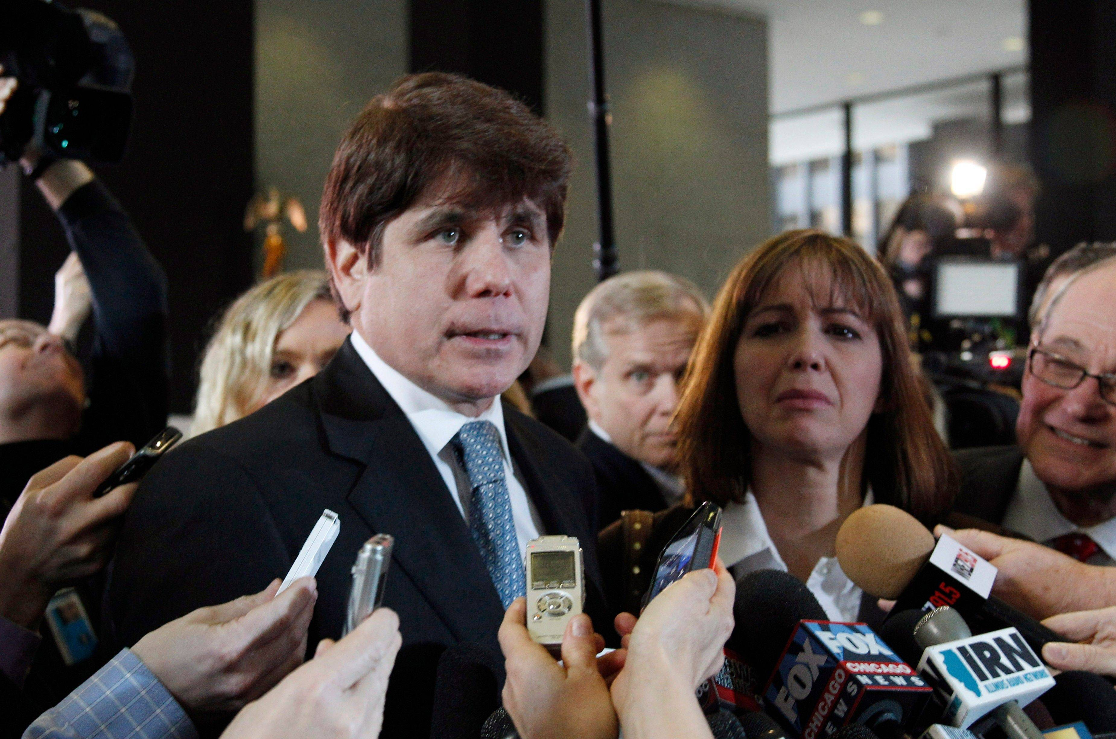 Former Gov. Rod Blagojevich speaks to reporters at the federal building in Chicago on Dec. 7 after being sentenced for 14 years on 18 corruption counts.