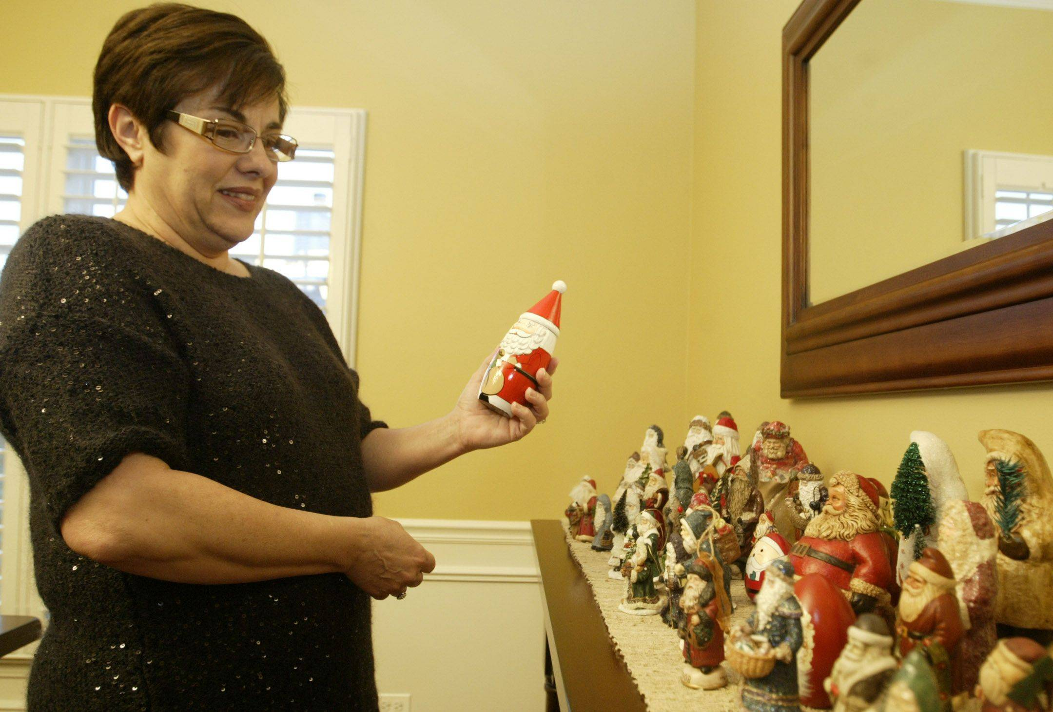 Jan Rohlf has nine Christmas trees and more than 500 ornaments decorating them in her Gilberts home. It takes her three full days to set up her different themed trees, which include a Santa tree, an old-fashioned tree, and figurine tree. Then for six to seven weeks, she sits back and enjoys the display until packing everything up until next year.