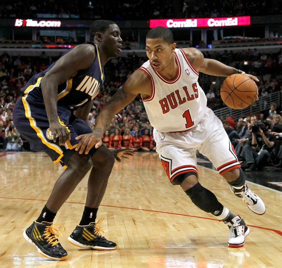 Chicago Bulls point guard Derrick Rose, right, drives on Indiana Pacers point guard Darren Collison, during the second half of an NBA preseason basketball game yesterday. The Bulls won 93-85.