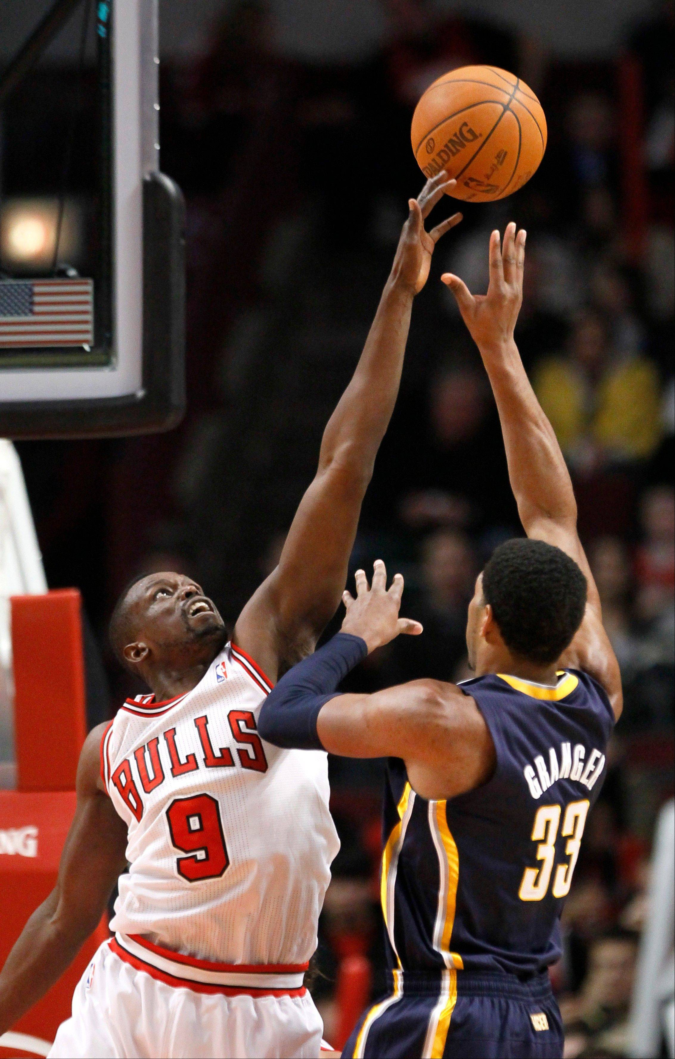 Luol Deng blocks the shot of Pacers small forward Danny Granger on Tuesday at the United Center. The game drew the highest TV ratings ever for a Bulls preseason game.