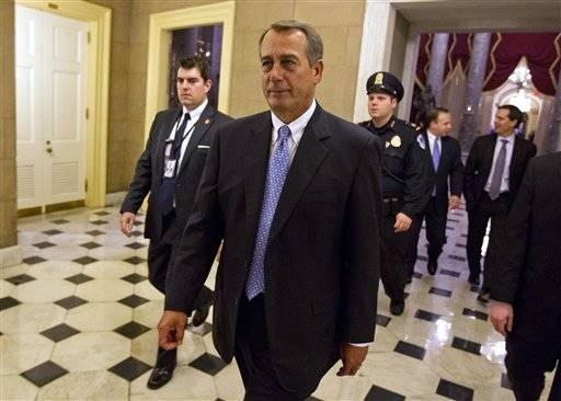 In this Dec. 20, 2011, photo, House Speaker John Boehner of Ohio walks off the floor of the House chamber in Washington.