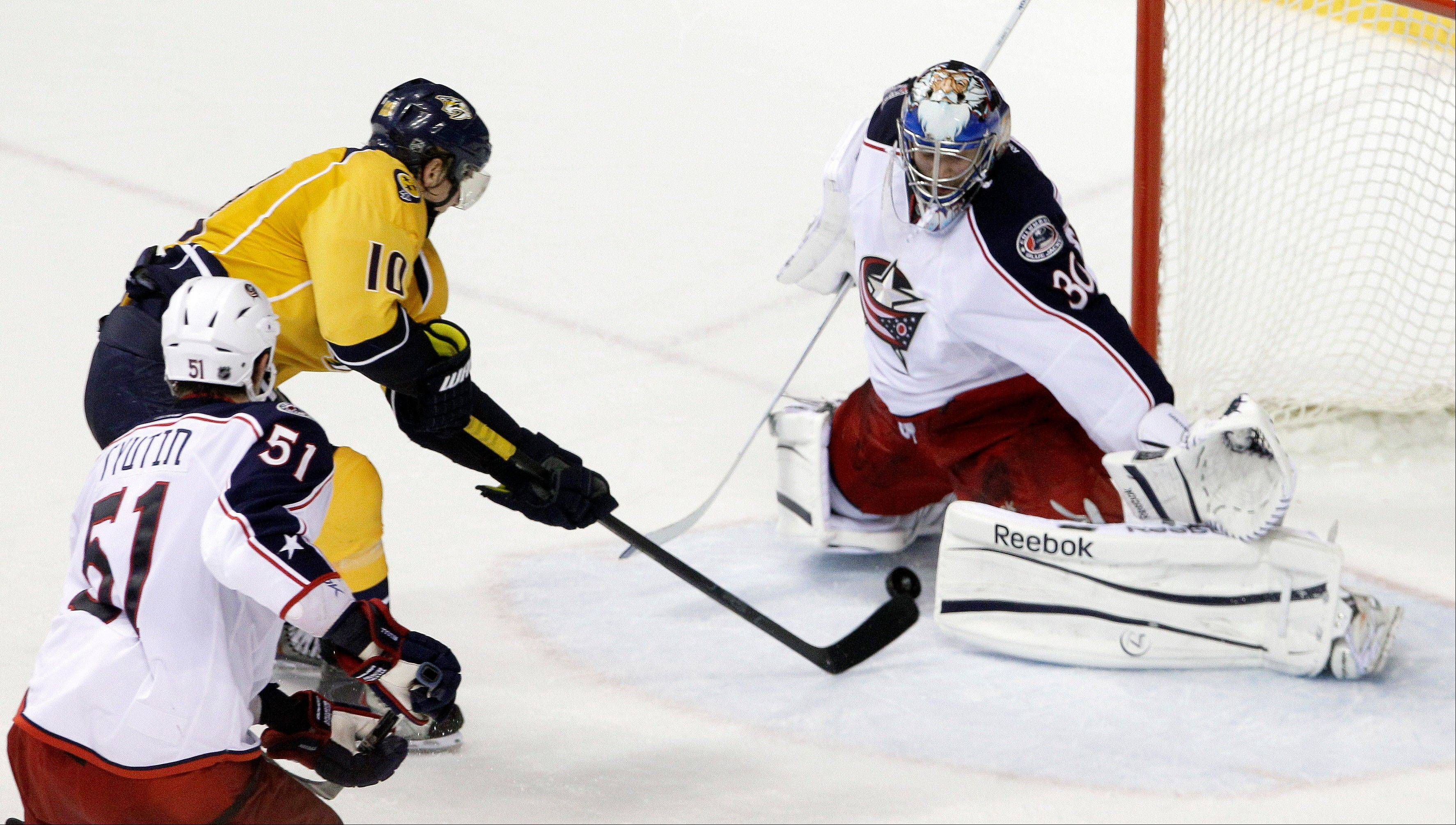 Nashville Predators left wing Martin Erat scores the game-winning goal against Columbus Blue Jackets goalie Curtis Sanford with 8.4 seconds left Thursday in Nashville.