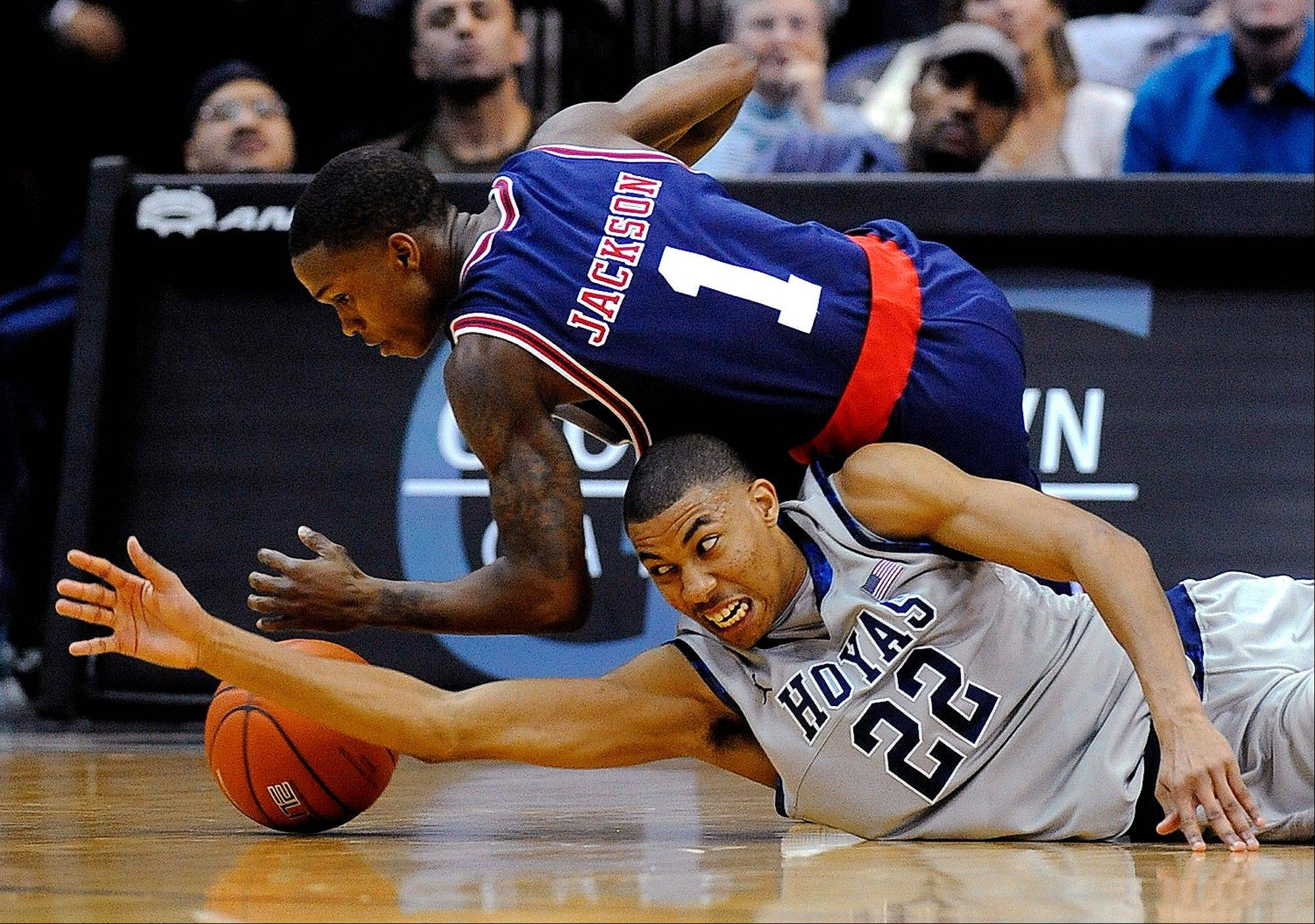 Memphis guard Joe Jackson and Georgetown forward Otto Porter dive for a loose ball Thursday in Washington.