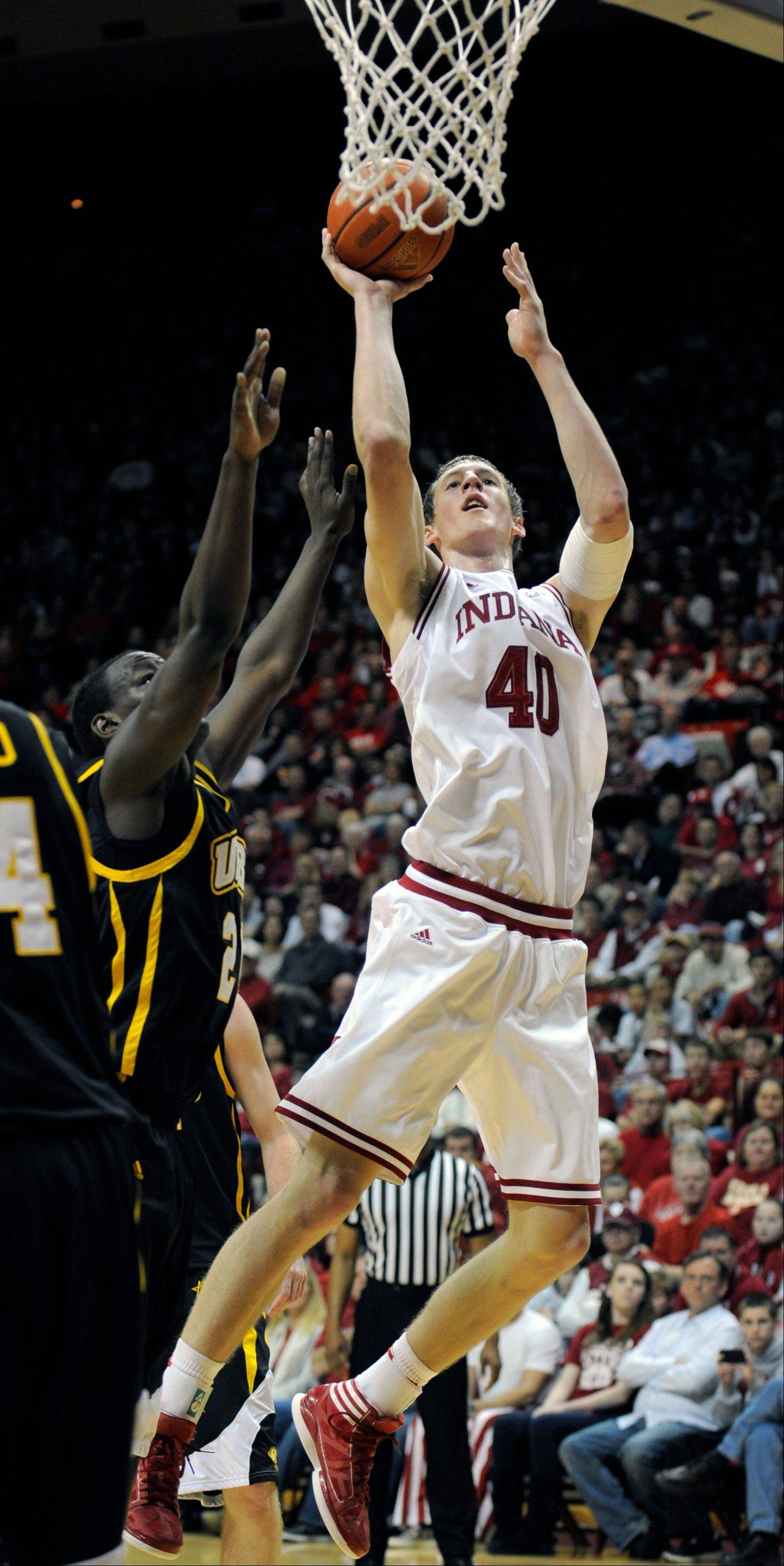 Indiana�s Cody Zeller puts up a shot over UMBC�s Jamar Wertz Thursday in Bloomington, Ind.