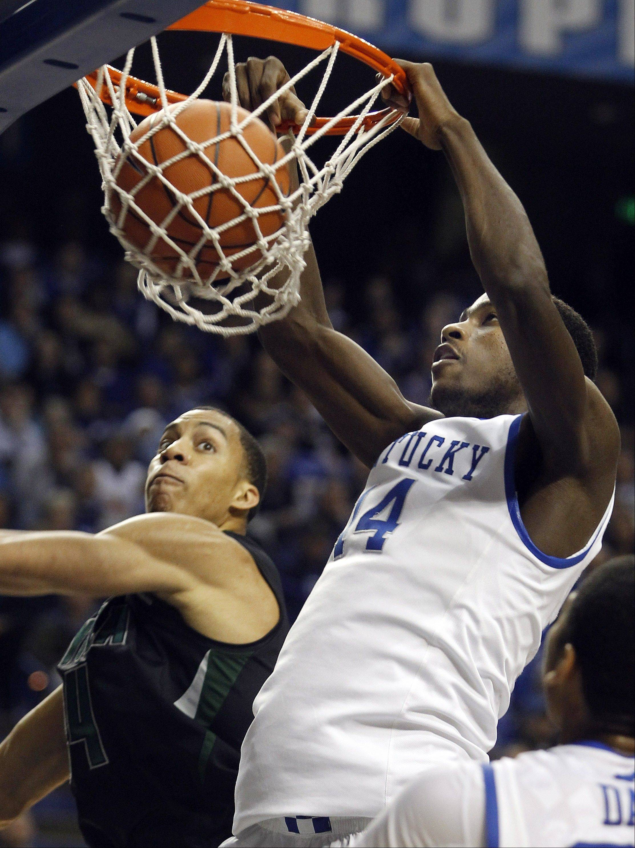 Kentucky�s Michael Kidd-Gilchrist, right, dunks on Loyola�s Erik Etherly Thursday in Lexington, Ky.