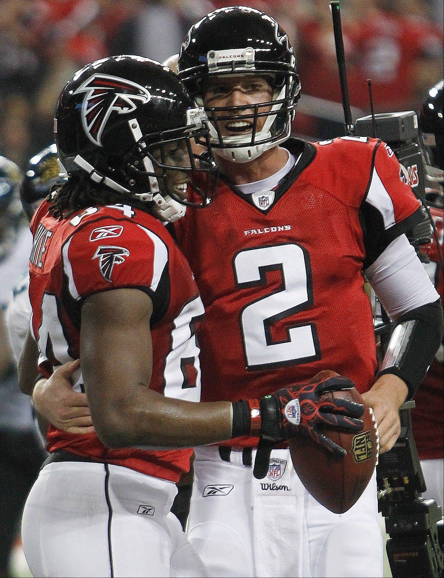 Atlanta quarterback Matt Ryan celebrates with Roddy White after 1 of White's 2 TD catches last Thursday against Jacksonville. Ryan has 7 TD passes the last two weeks and is a fantastic play this week at New Orleans.
