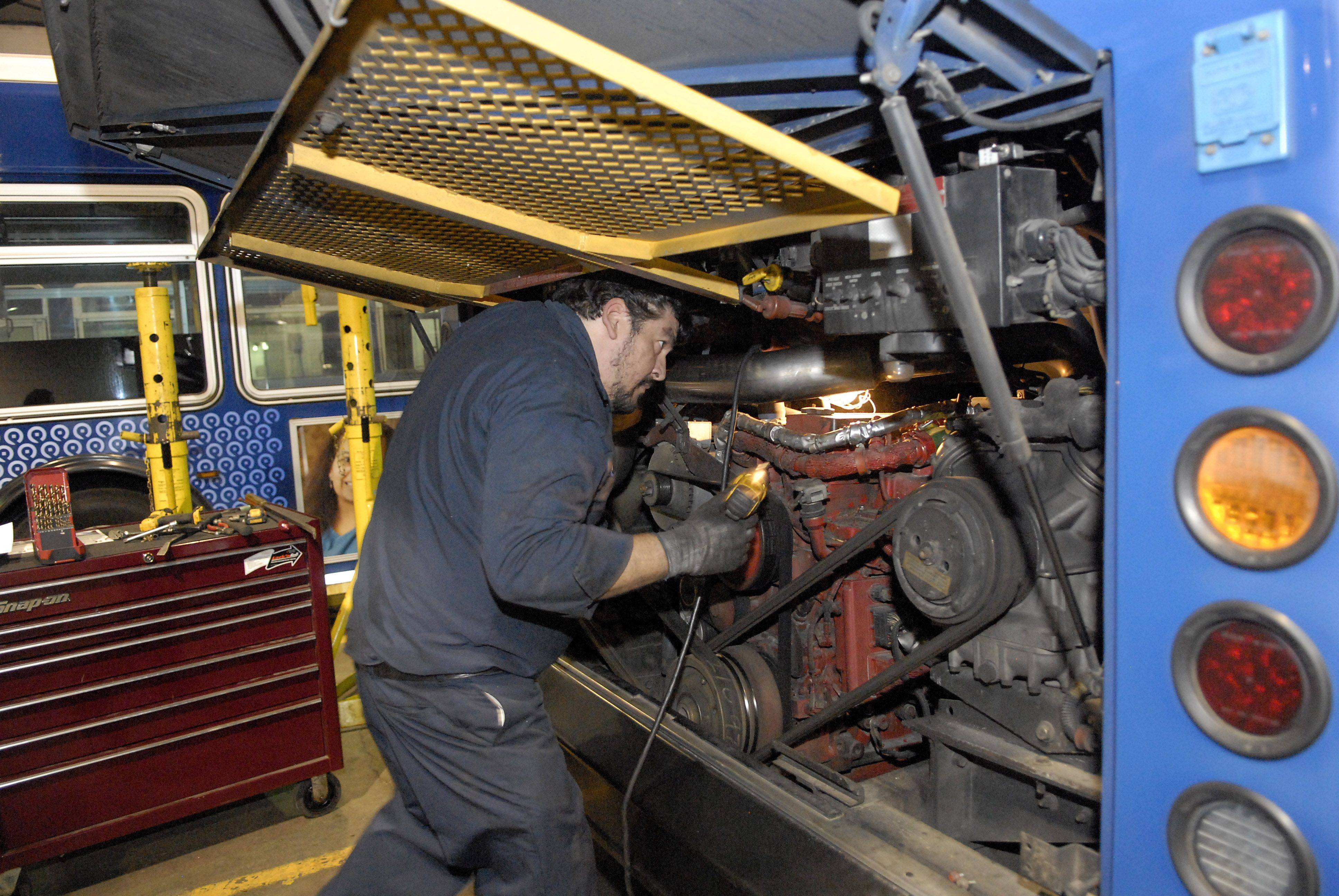 Mechanic Vic Oseguera completes a work order for diesel engine repairs. Oseguera has been with Pace for 24 years.