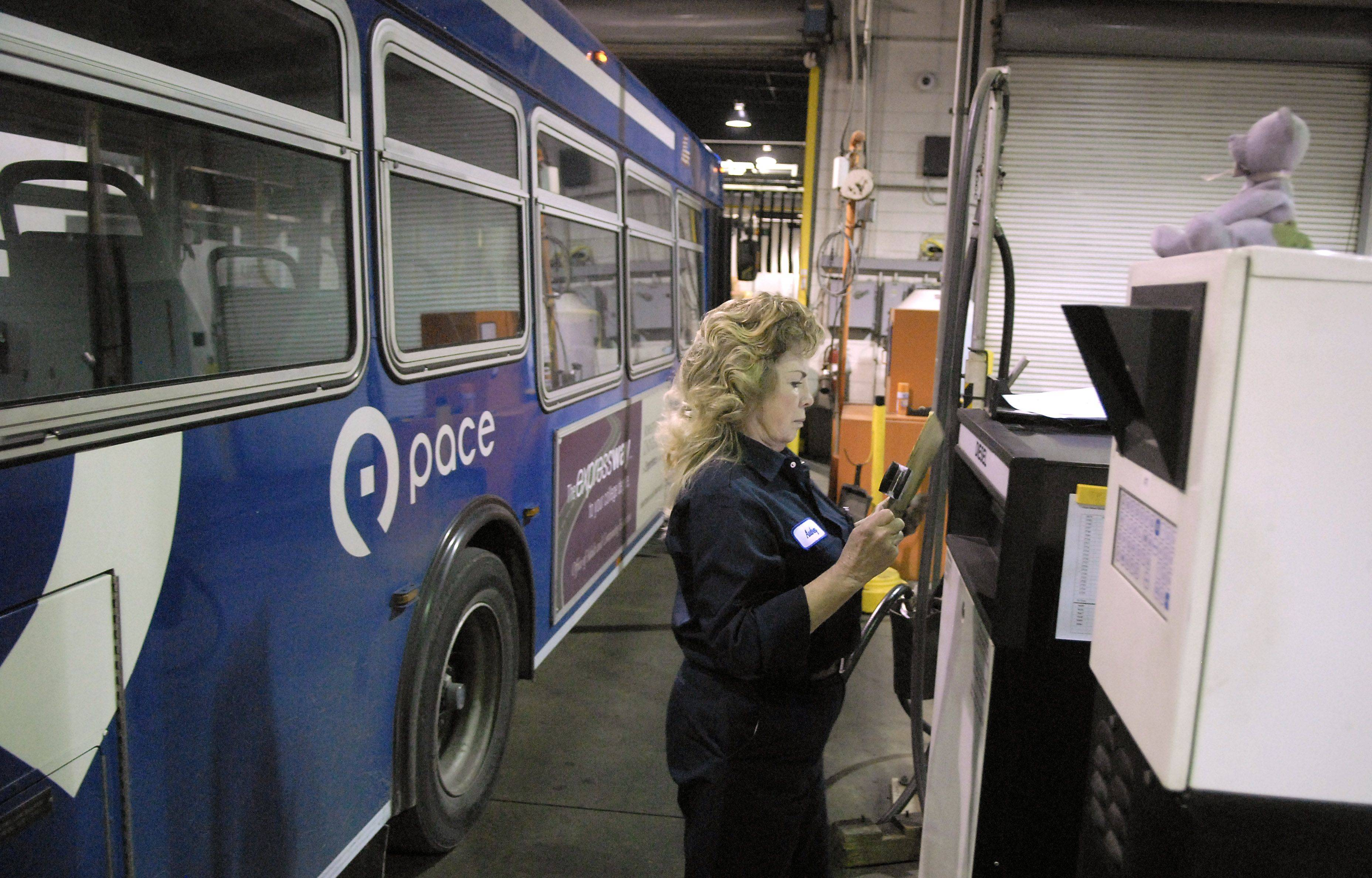Service worker Audrey Huebner reviews the work order for a bus at the fueling station. Service workers refuel all buses as they come in for the night and run them through the bus wash. Huebner has been with Pace for seven years.
